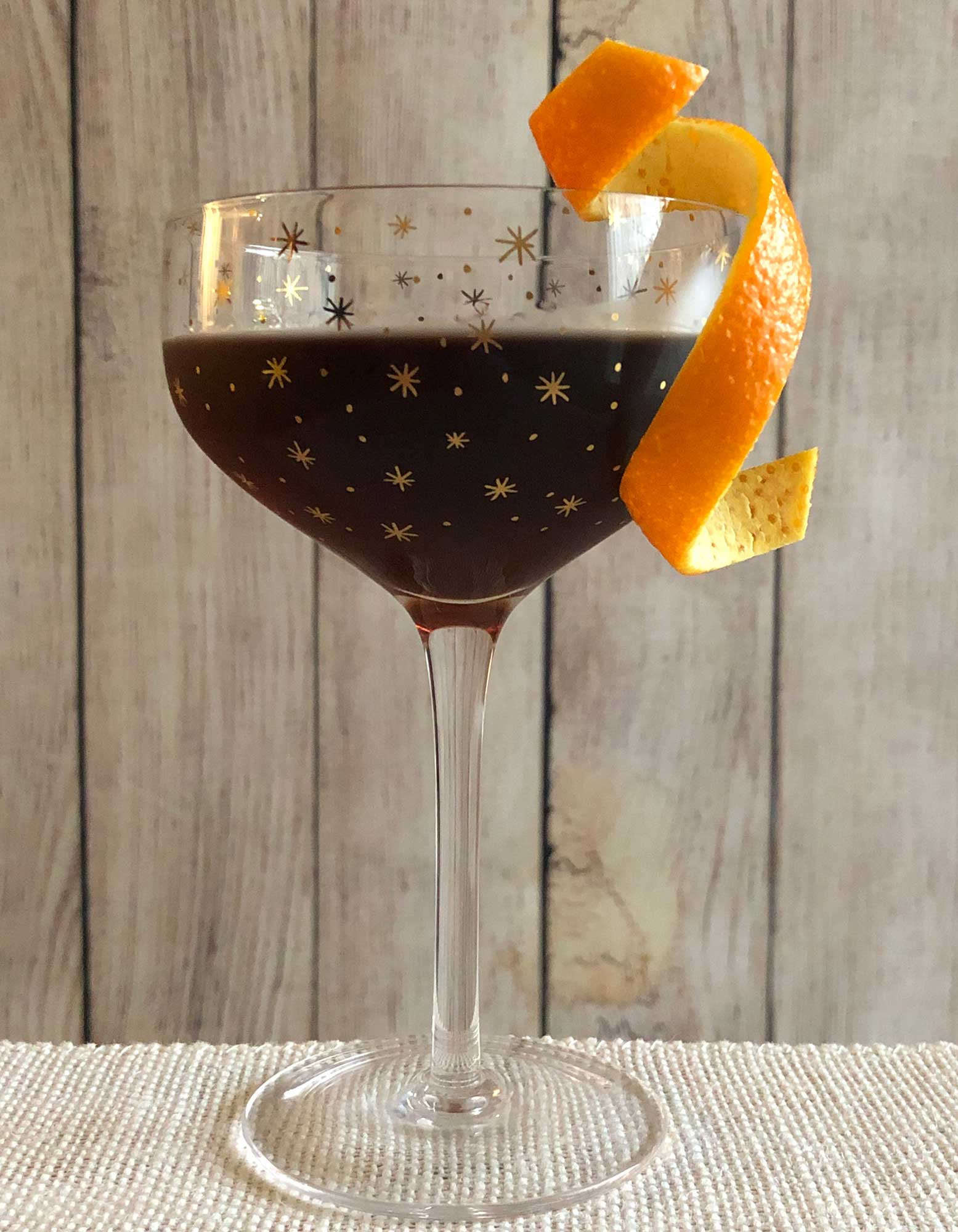 An example of the El Poco Loco, the mixed drink (cocktail) featuring Hayman's Old Tom Gin, Dolin Rouge Vermouth de Chambéry, and Nux Alpina Walnut Liqueur; photo by Lee Edwards