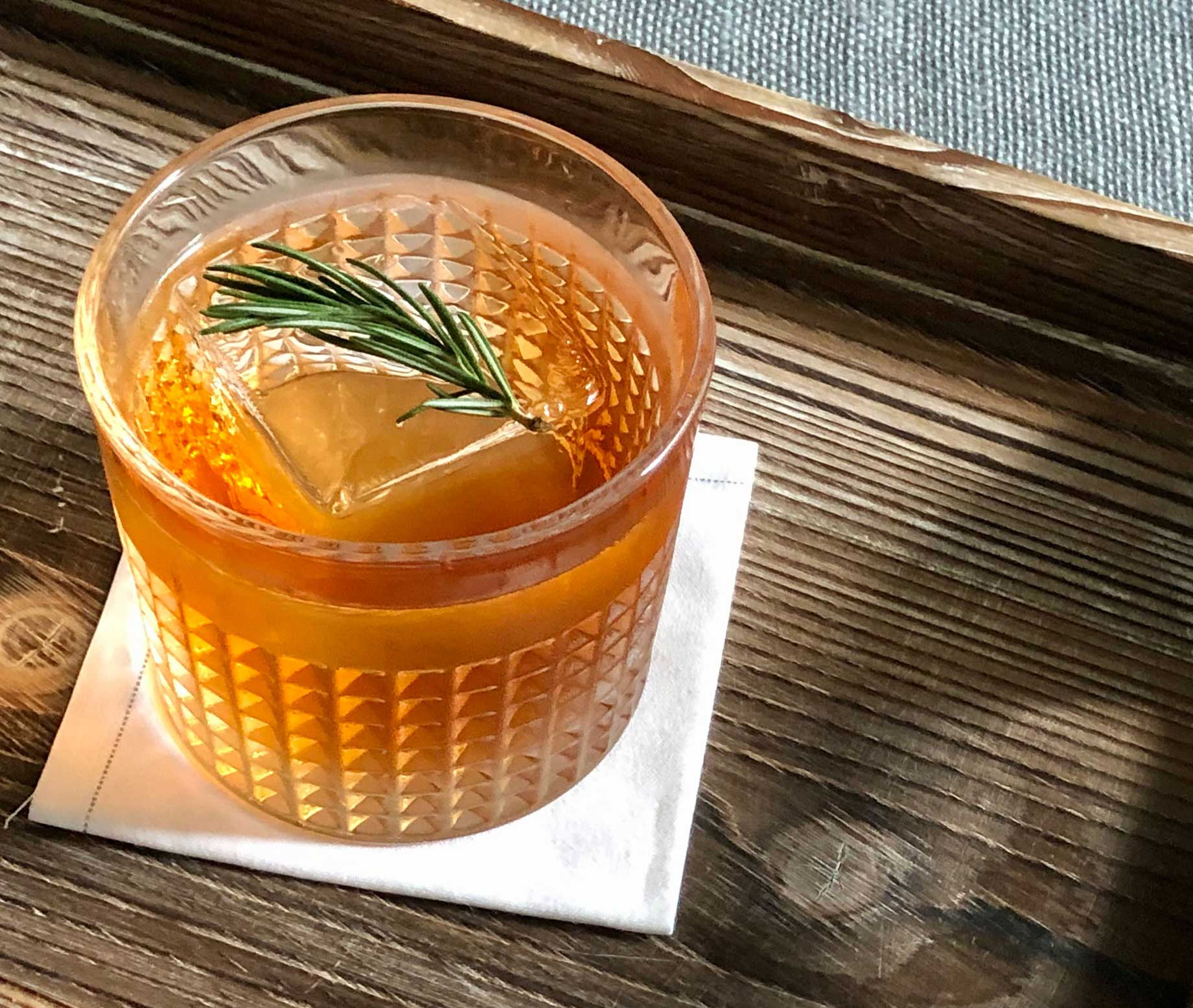 An example of the Schleswig Limbo, the mixed drink (cocktail), adapted from a drink by Luiggi Uzcategui, Big Orange, Little Rock, Arkansas, featuring Purkhart Pear Williams Eau-de-Vie, The Scarlet Ibis Trinidad Rum, Rothman & Winter Orchard Cherry Liqueur, and Aperitivo Cappelletti; photo by Lee Edwards
