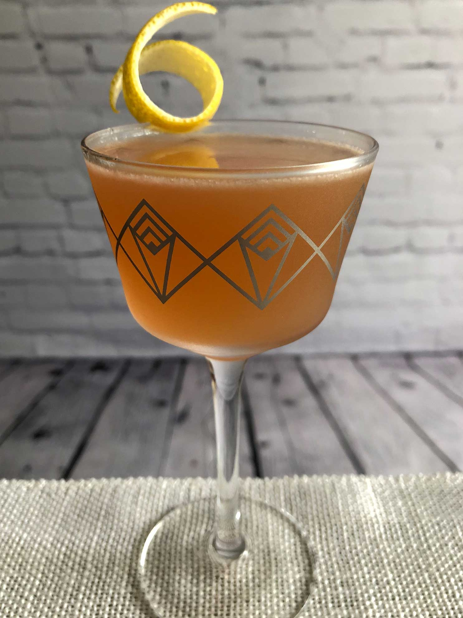 An example of the Jazz Flute, the mixed drink (cocktail), by riff on Gilchrist, PDT book, featuring scotch whisky, Purkhart Pear Williams Eau-de-Vie, pink grapefruit juice, Cardamaro Vino Amaro, simple syrup, and grapefruit bitters; photo by Lee Edwards