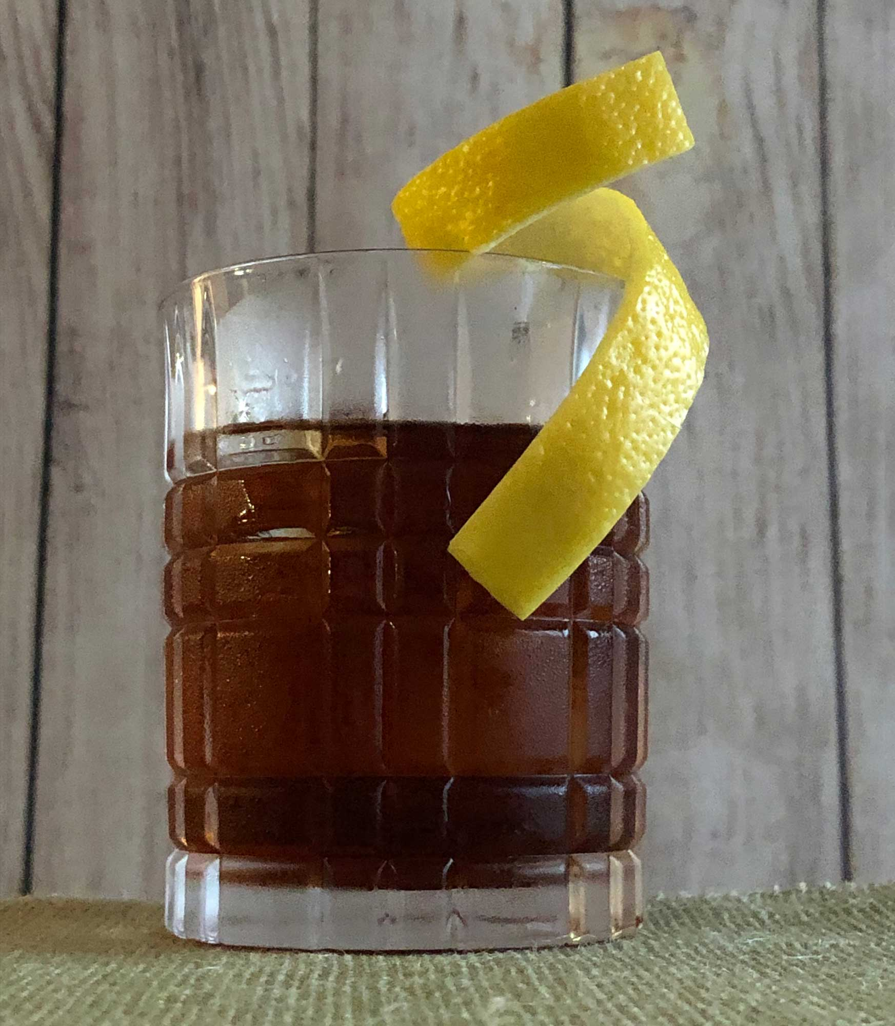 An example of the Juneau, the mixed drink (cocktail), by Lee Edwards, featuring Purkhart Pear Williams Eau-de-Vie, Dolin Génépy le Chamois Liqueur, Nux Alpina Walnut Liqueur, Angostura bitters, and crème de cacao (white); photo by Lee Edwards