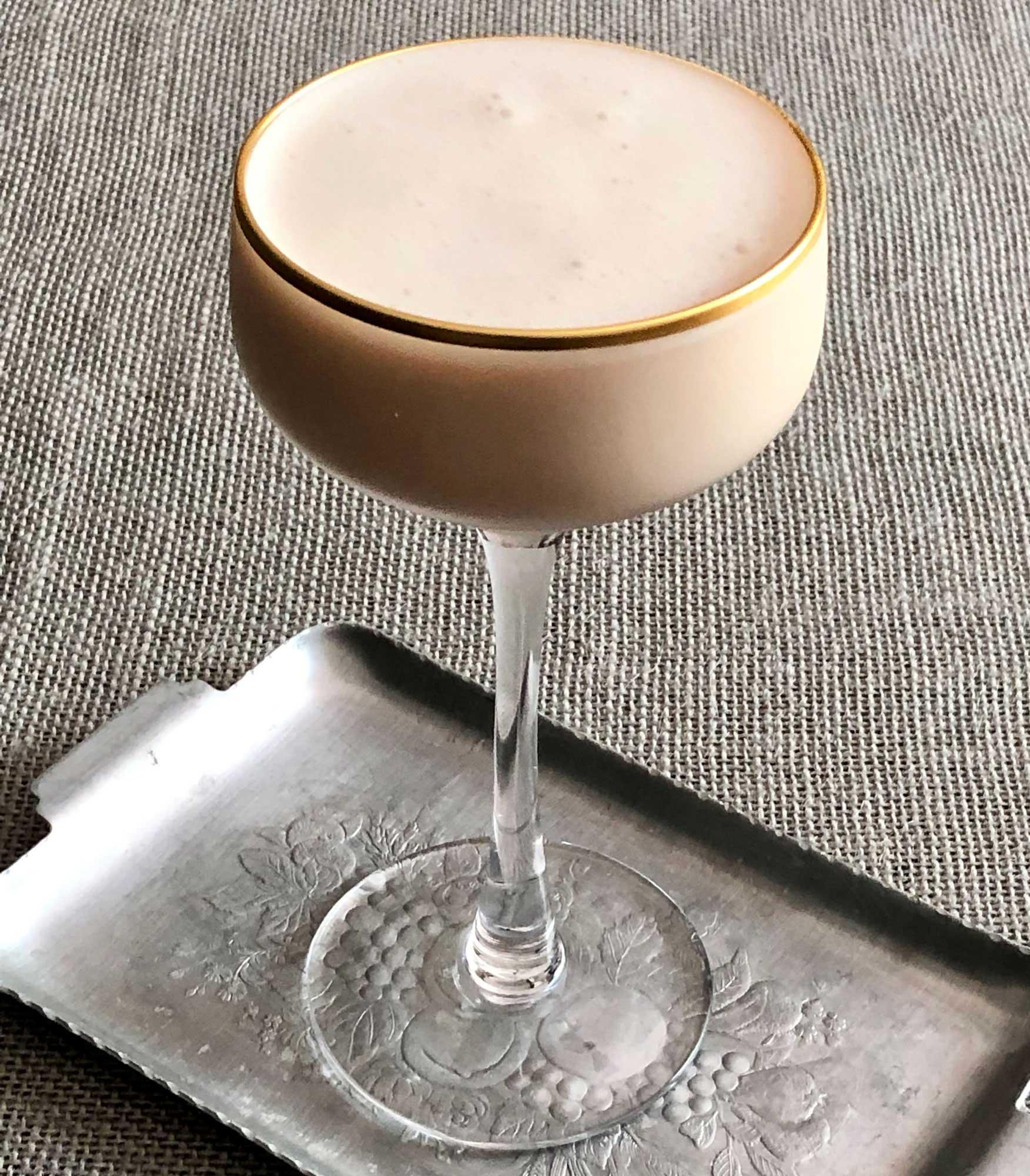 An example of the Juneau Suisse, the mixed drink (cocktail) featuring Purkhart Pear Williams Eau-de-Vie, cream, Dolin Génépy le Chamois Liqueur, Nux Alpina Walnut Liqueur, Angostura bitters, and crème de cacao (white); photo by Lee Edwards