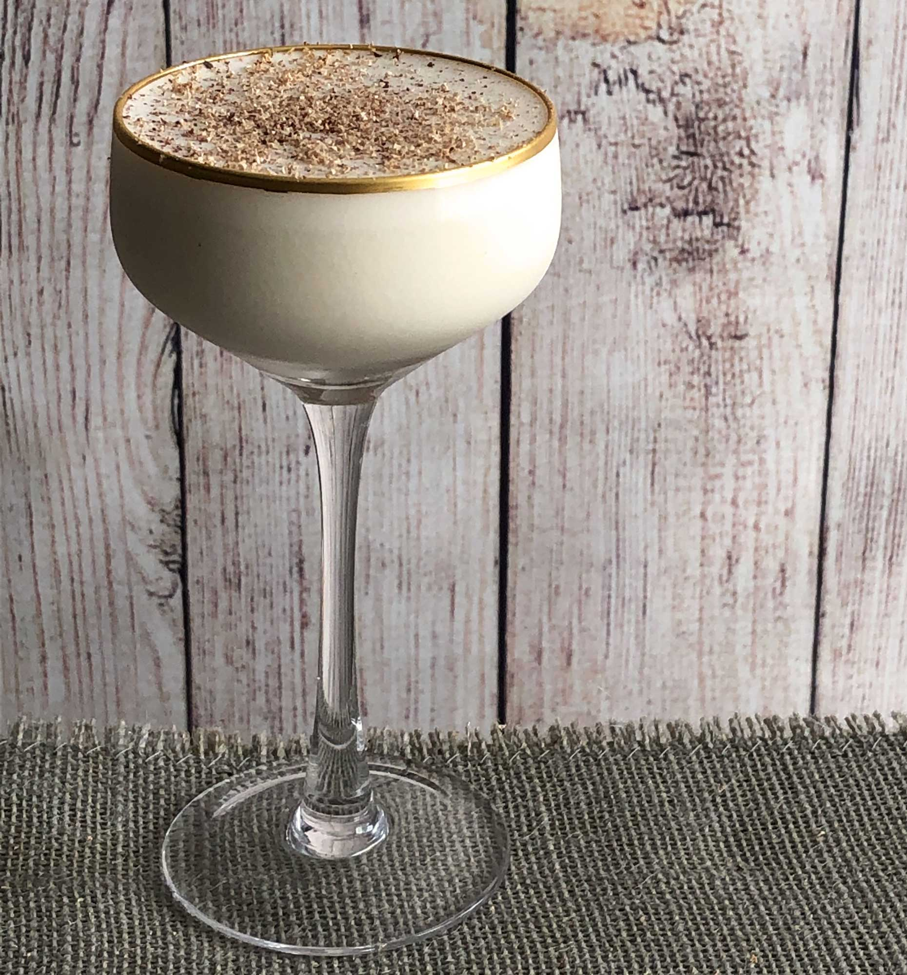 """An example of the Barbary Coast, the mixed drink (cocktail), variation of a drink from the Savoy Cocktail Book, featuring Tresmontaine """"tabacal"""" Rancio, Hayman's London Dry Gin, crème de cacao (white), and cream; photo by Lee Edwards"""