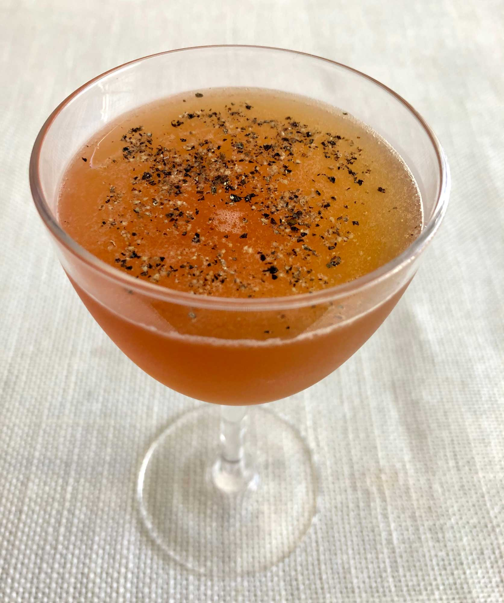 An example of the Tellicherry Cruiser, the mixed drink (cocktail), variation of the Philomel from the Savoy Cocktail Book, featuring Matifoc Rancio Sec, orange juice, Smith & Cross Traditional Jamaica Rum, Bonal Gentiane-Quina, and Byrrh Grand Quinquina; photo by Lee Edwards