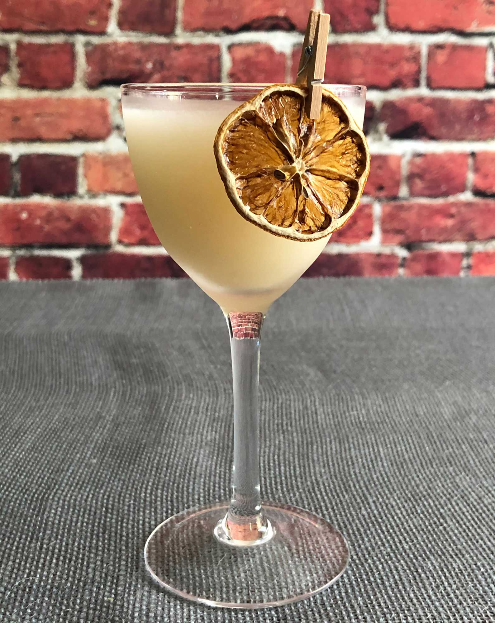 An example of the Royal Hawaiian, the mixed drink (cocktail) featuring Hayman's Royal Dock Navy Strength Gin, pineapple juice, orgeat, and lemon juice; photo by Lee Edwards