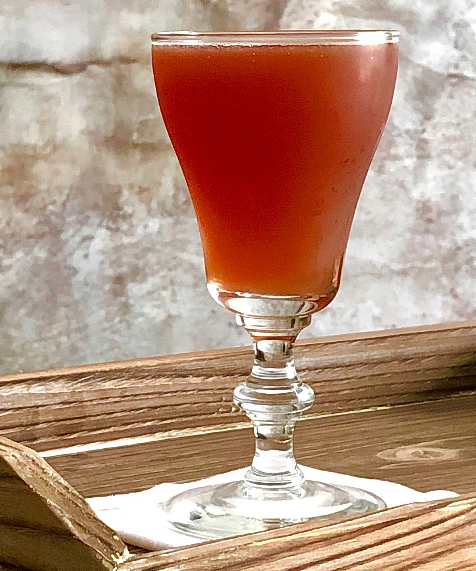 An example of the Plum Billet, the mixed drink (cocktail), variation on the Pruneaux cocktail, Savoy Cocktail Book, featuring Hayman's Royal Dock Navy Strength Gin, Terres des Templiers Rancio Sec, orange juice, Byrrh Grand Quinquina, simple syrup, and Angostura bitters; photo by Lee Edwards
