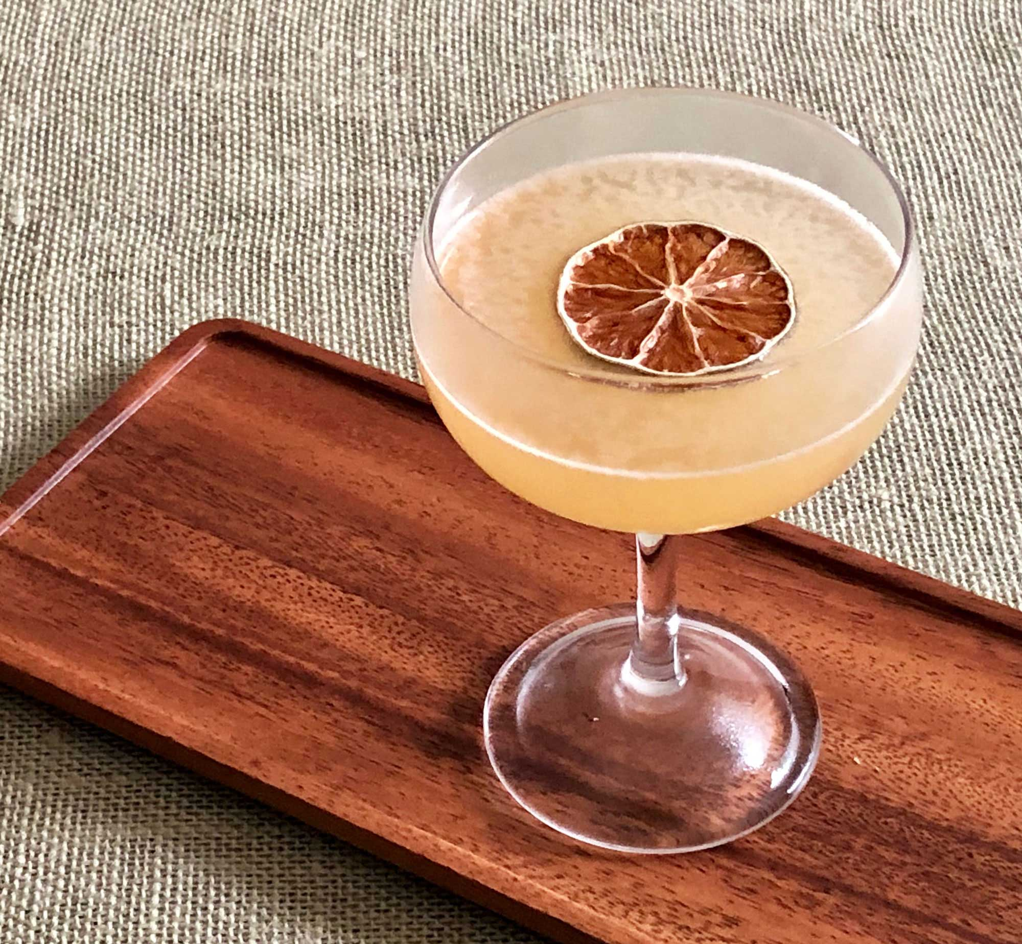 An example of the To The Sun, the mixed drink (cocktail) featuring Smith & Cross Traditional Jamaica Rum, lime juice, Rothman & Winter Orchard Apricot Liqueur, John D. Taylor's Velvet Falernum, and Angostura bitters; photo by Lee Edwards