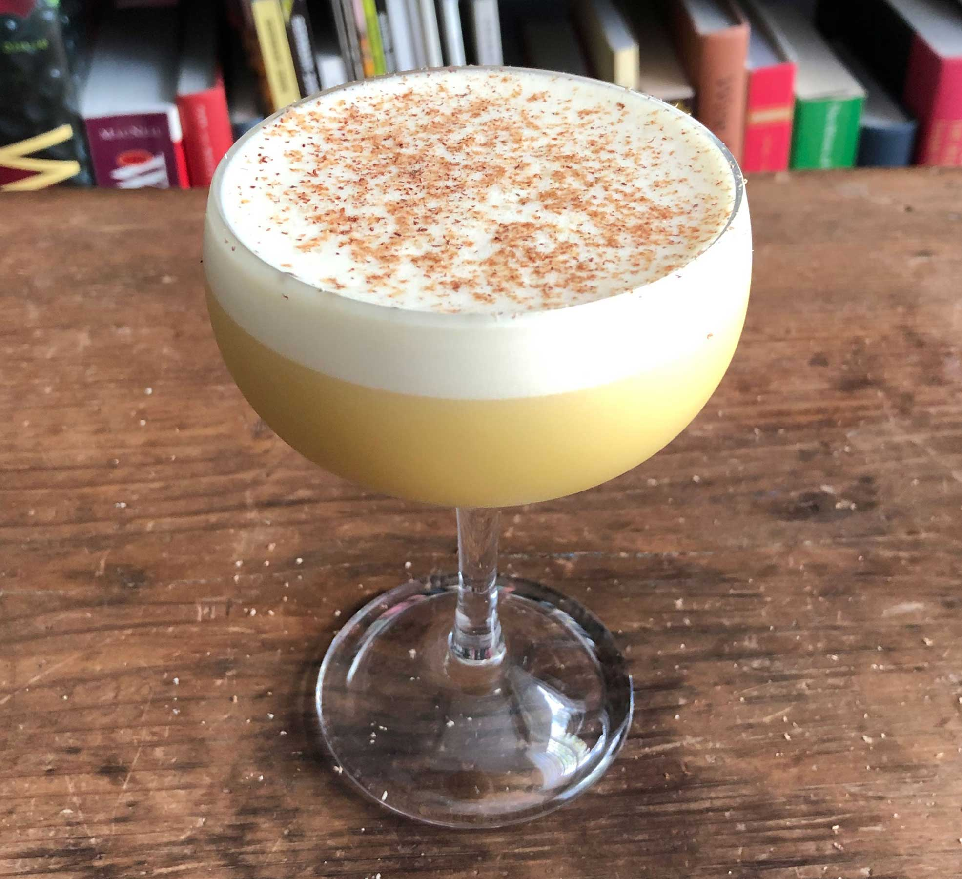 An example of the Apricot Flip, the mixed drink (flip), by John Deragon, PDT, New York City, featuring cognac, raw egg, Rothman & Winter Orchard Apricot Liqueur, and simple syrup; photo by Lee Edwards