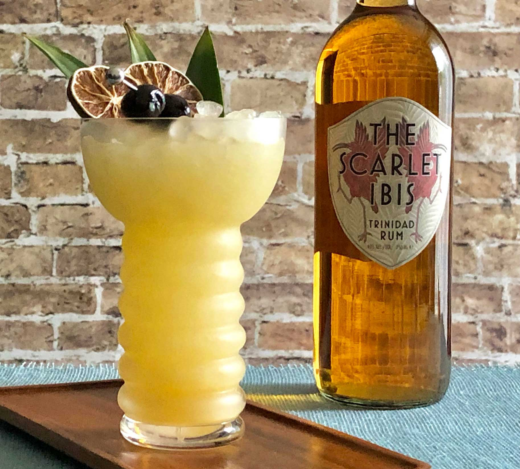 An example of the The Beachbum, the mixed drink (cocktail), by John Deragon, PDT, New York City, featuring The Scarlet Ibis Trinidad Rum, light rum, pineapple juice, lime juice, Rothman & Winter Orchard Apricot Liqueur, and orgeat