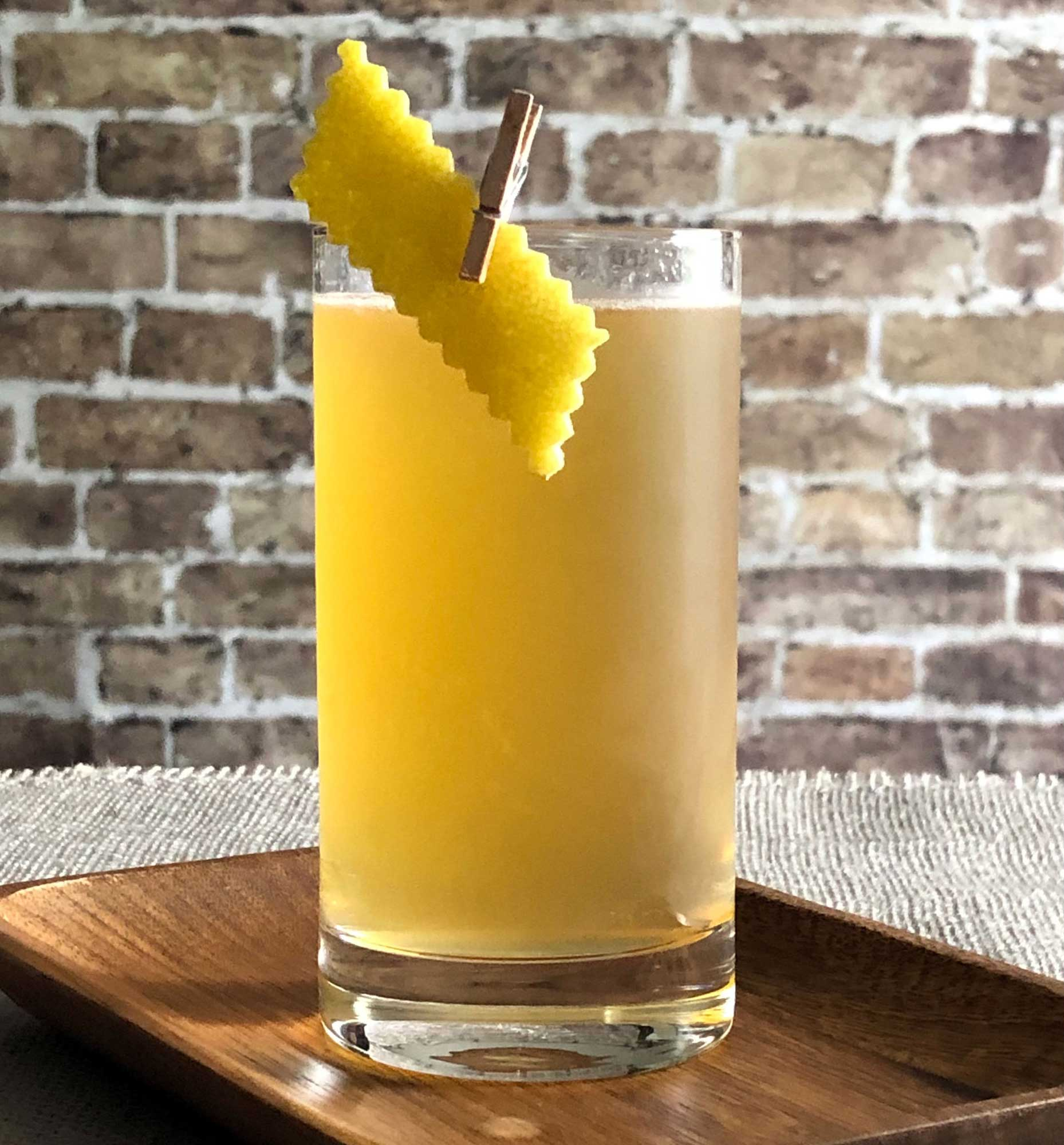 An example of the Apricot Beer Collins, the mixed drink (collins) featuring white beer, Hayman's Old Tom Gin, Rothman & Winter Orchard Apricot Liqueur, and lemon juice; photo by Lee Edwards