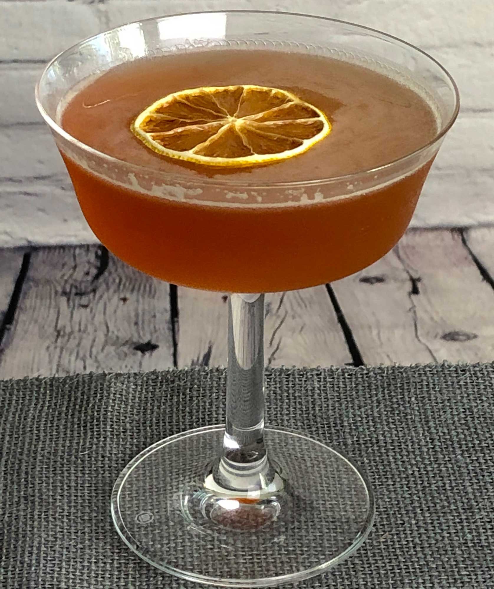 An example of the Hi-Hat Cocktail, the mixed drink (cocktail), variation of a drink from David Embury, The Fine Art of Mixing Drinks, featuring rye whiskey, Rothman & Winter Orchard Cherry Liqueur, and lemon juice; photo by Lee Edwards