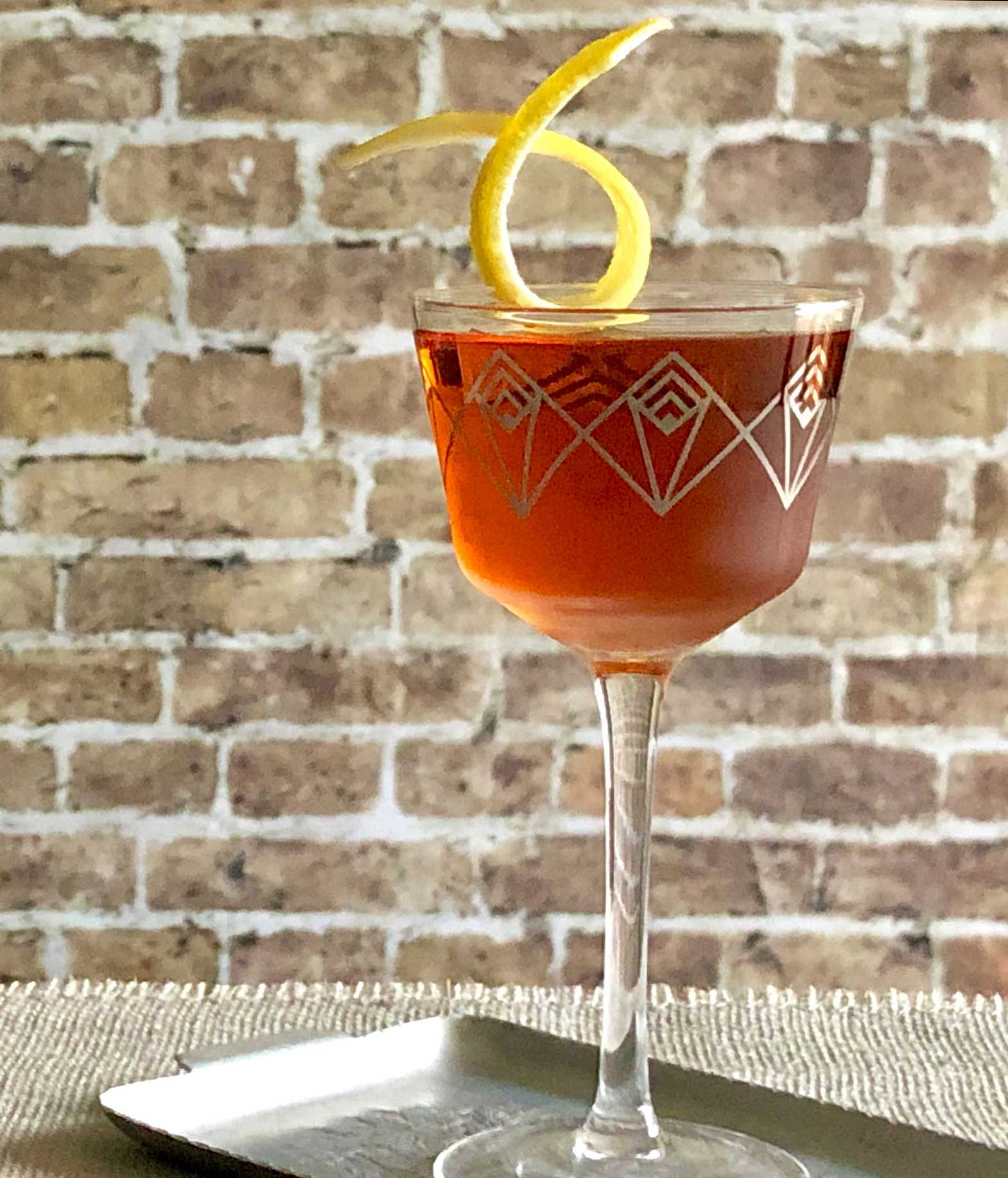 An example of the Southampton, the mixed drink (cocktail), variation of a drink from David Embury, The Fine Art of Mixing Drinks, featuring cognac, Rothman & Winter Orchard Cherry Liqueur, and Angostura bitters; photo by Lee Edwards