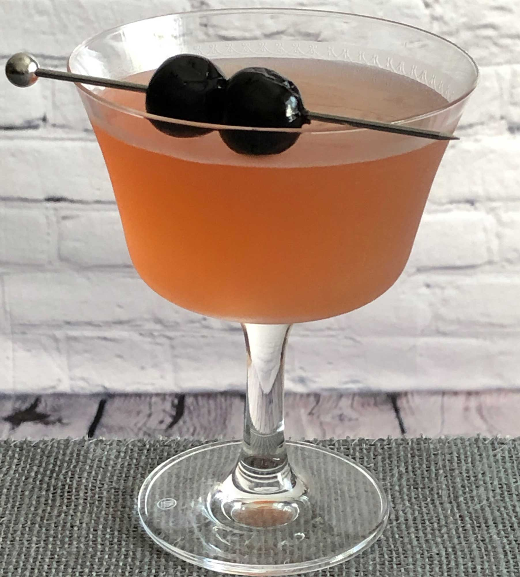 An example of the Admiral, the mixed drink (cocktail), variation of a drink from David Embury, The Fine Art of Mixing Drinks, featuring Hayman's London Dry Gin, Rothman & Winter Orchard Cherry Liqueur, and lime juice; photo by Lee Edwards