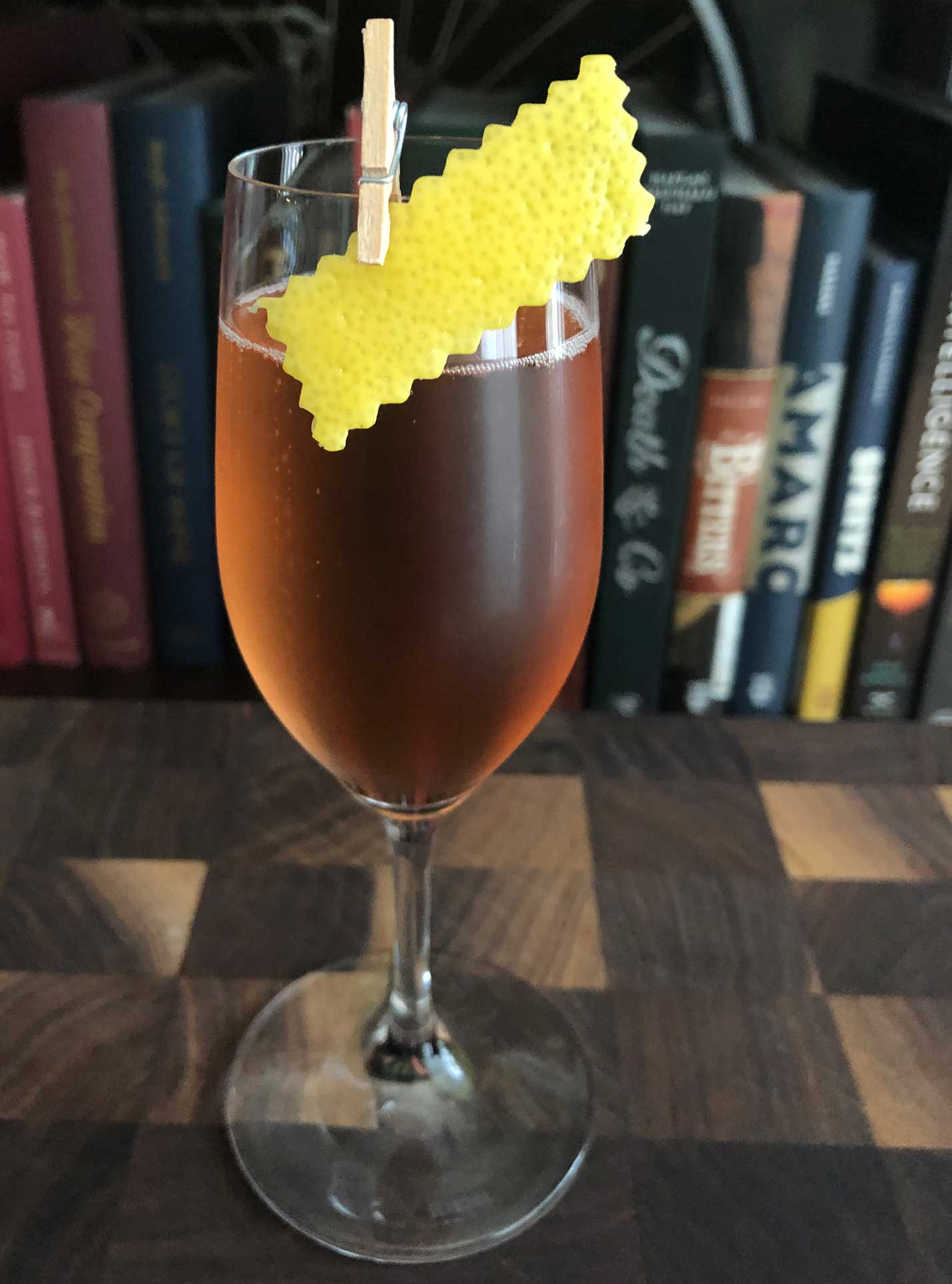 An example of the Inspector Clouseau, the mixed drink (cocktail) featuring sparkling wine, Dolin Blanc Vermouth de Chambéry, and Rothman & Winter Orchard Cherry Liqueur; photo by Lee Edwards