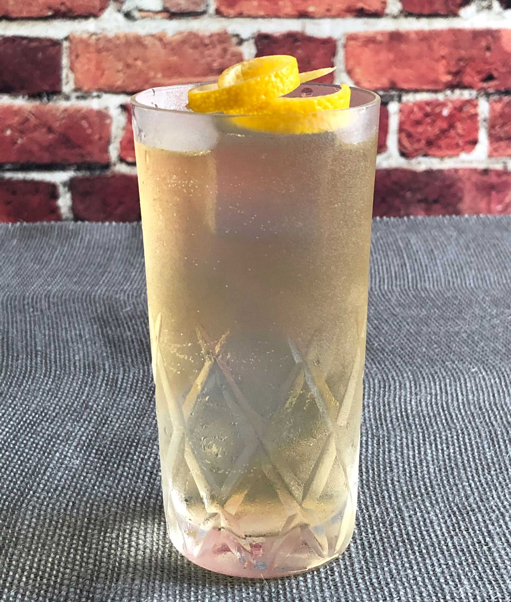 An example of the Auvergne Summer, the mixed drink (cocktail) featuring Rothman & Winter Orchard Peach Liqueur, Salers Gentian Apéritif, and soda water; photo by Lee Edwards