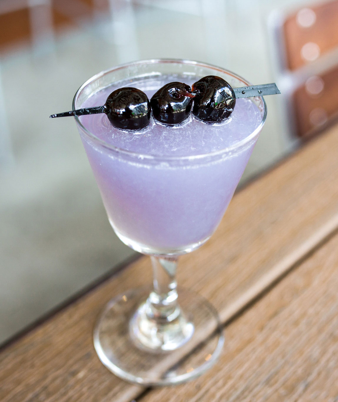 An example of the Aviation, the mixed drink (cocktail) featuring Hayman's London Dry Gin, lemon juice, maraschino liqueur, and Rothman & Winter Crème de Violette; photo by Carolina Stamey, STIR, Chattanooga