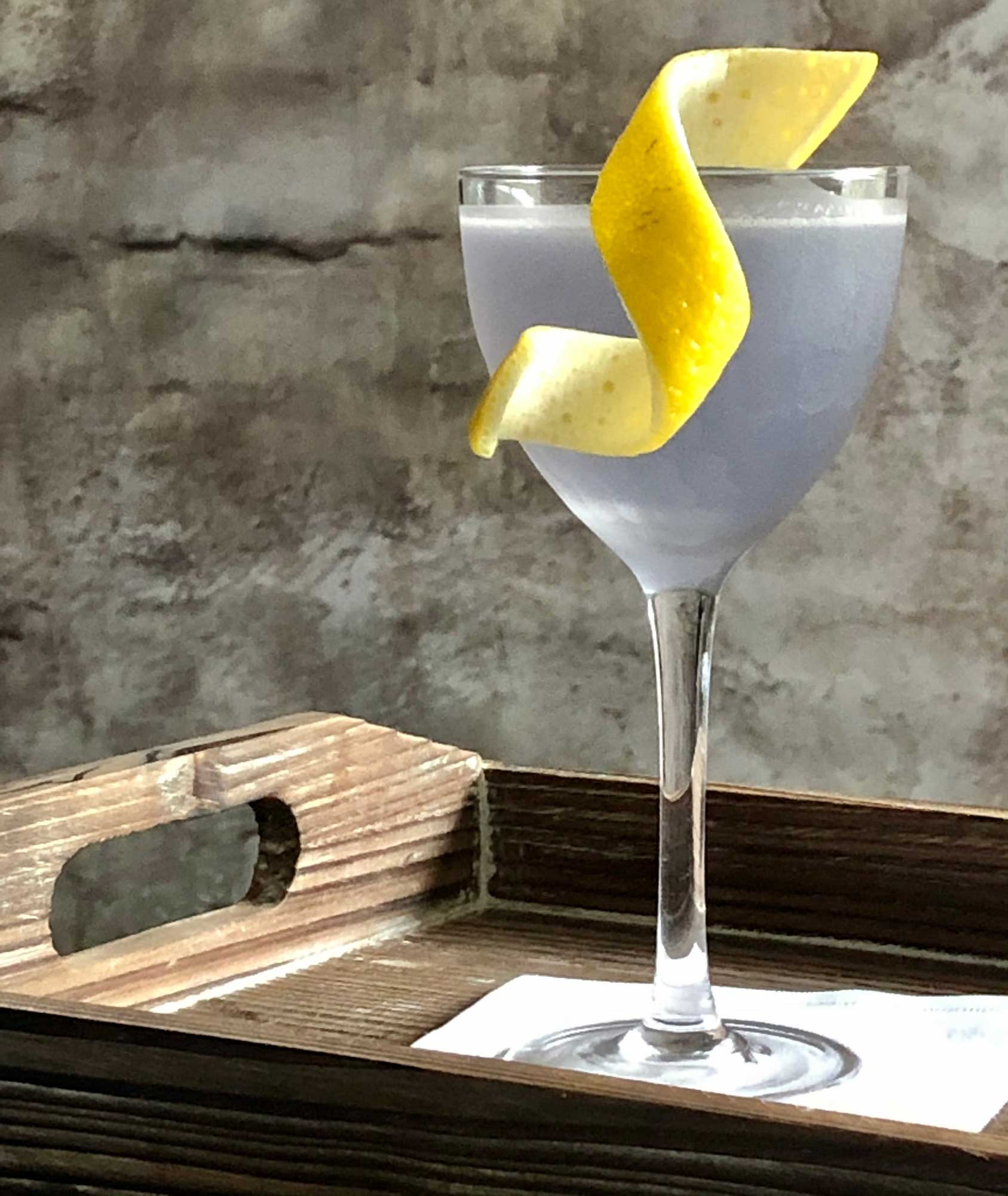 An example of the Blue Moon, the mixed drink (cocktail) featuring Hayman's London Dry Gin, Rothman & Winter Crème de Violette, and lemon juice; photo by Lee Edwards