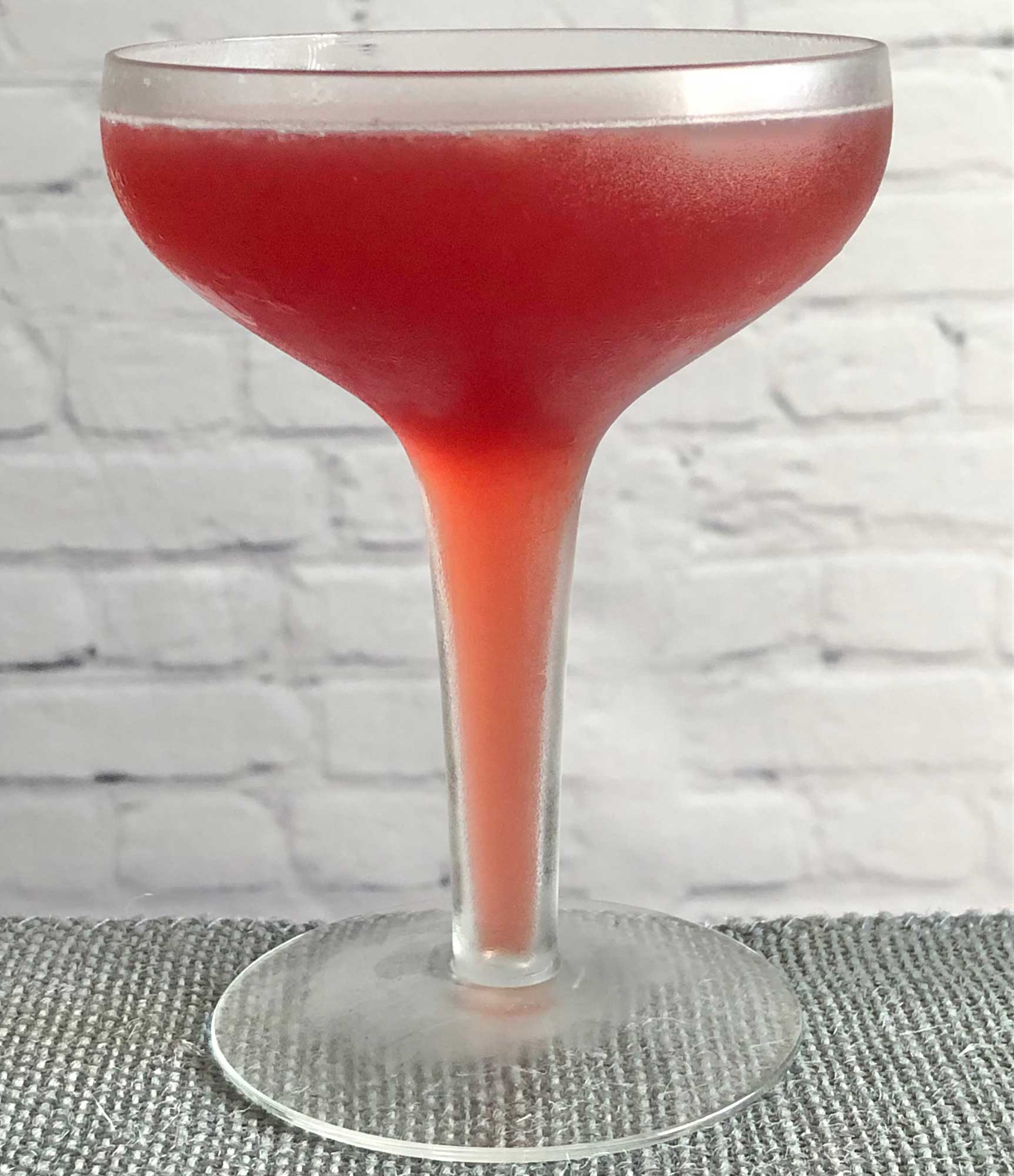 An example of the Robson Cocktail, the mixed drink (cocktail), by Savoy Cocktail Book, featuring Smith & Cross Traditional Jamaica Rum, grenadine, orange juice, lemon juice, and Angostura bitters; photo by Lee Edwards