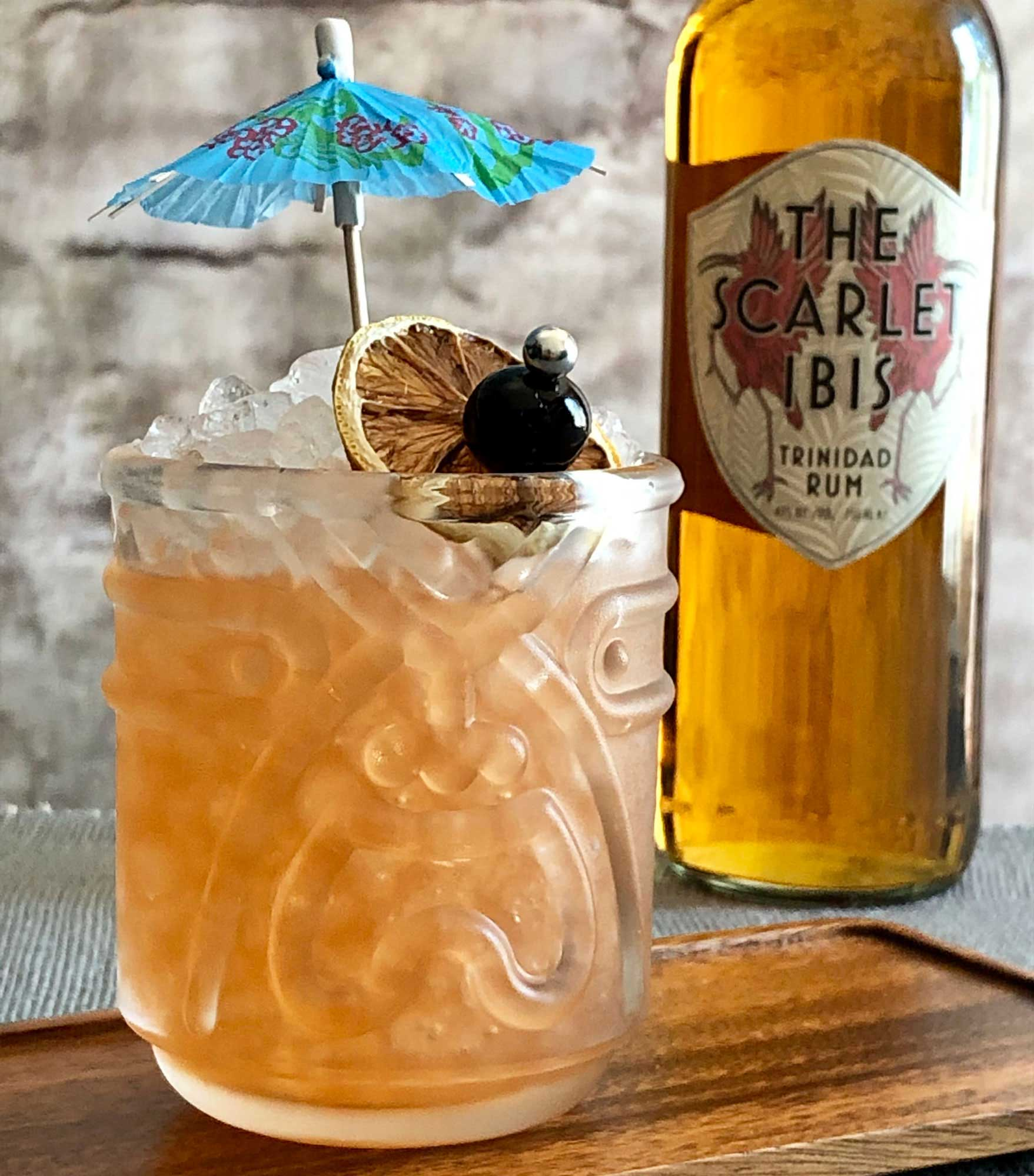 An example of the Test Pilot Punch, the mixed drink (punch), by based on a cocktail by Don the Beachcomber, featuring John D. Taylor's Velvet Falernum, Smith & Cross Traditional Jamaica Rum, The Scarlet Ibis Trinidad Rum, orange-flavored liqueur, lime juice, pastis, and Angostura bitters; photo by Lee Edwards