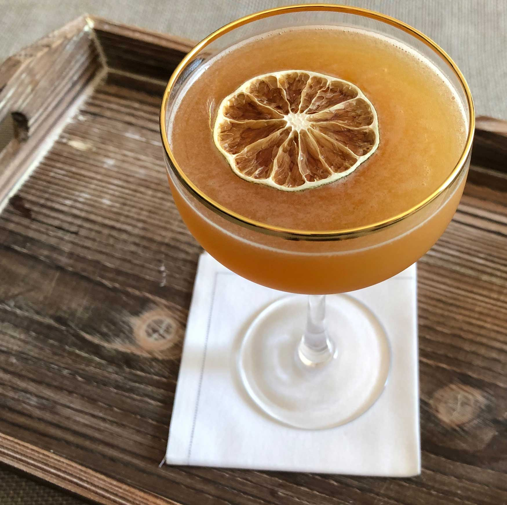 An example of the Navy Cross, the mixed drink (cocktail), by Alexandra Bookless, The Passenger, Washington, DC, featuring Smith & Cross Traditional Jamaica Rum, Cruzan Blackstrap Rum, John D. Taylor's Velvet Falernum, pineapple juice, lime juice, and St. Elizabeth Allspice Dram; photo by Lee Edwards