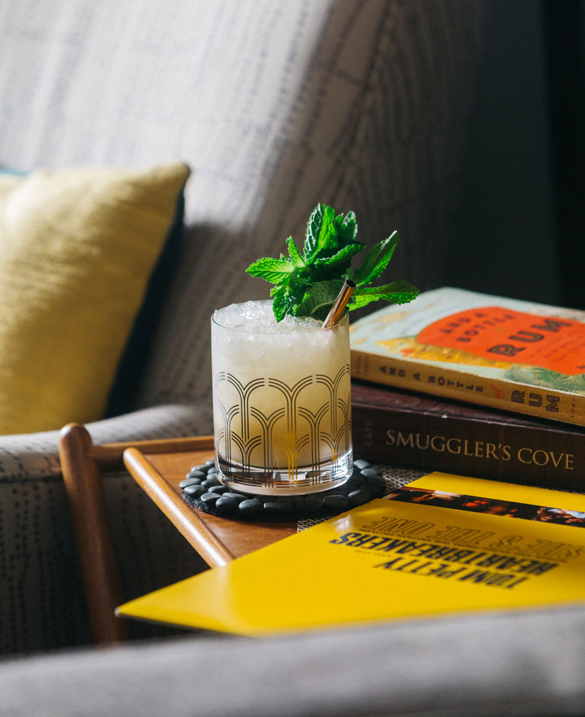 An example of the Mai Tai, the mixed drink (cocktail) featuring Smith & Cross Traditional Jamaica Rum, The Scarlet Ibis Trinidad Rum, orgeat, lime juice, and curaçao; photo by S. Kallstrand