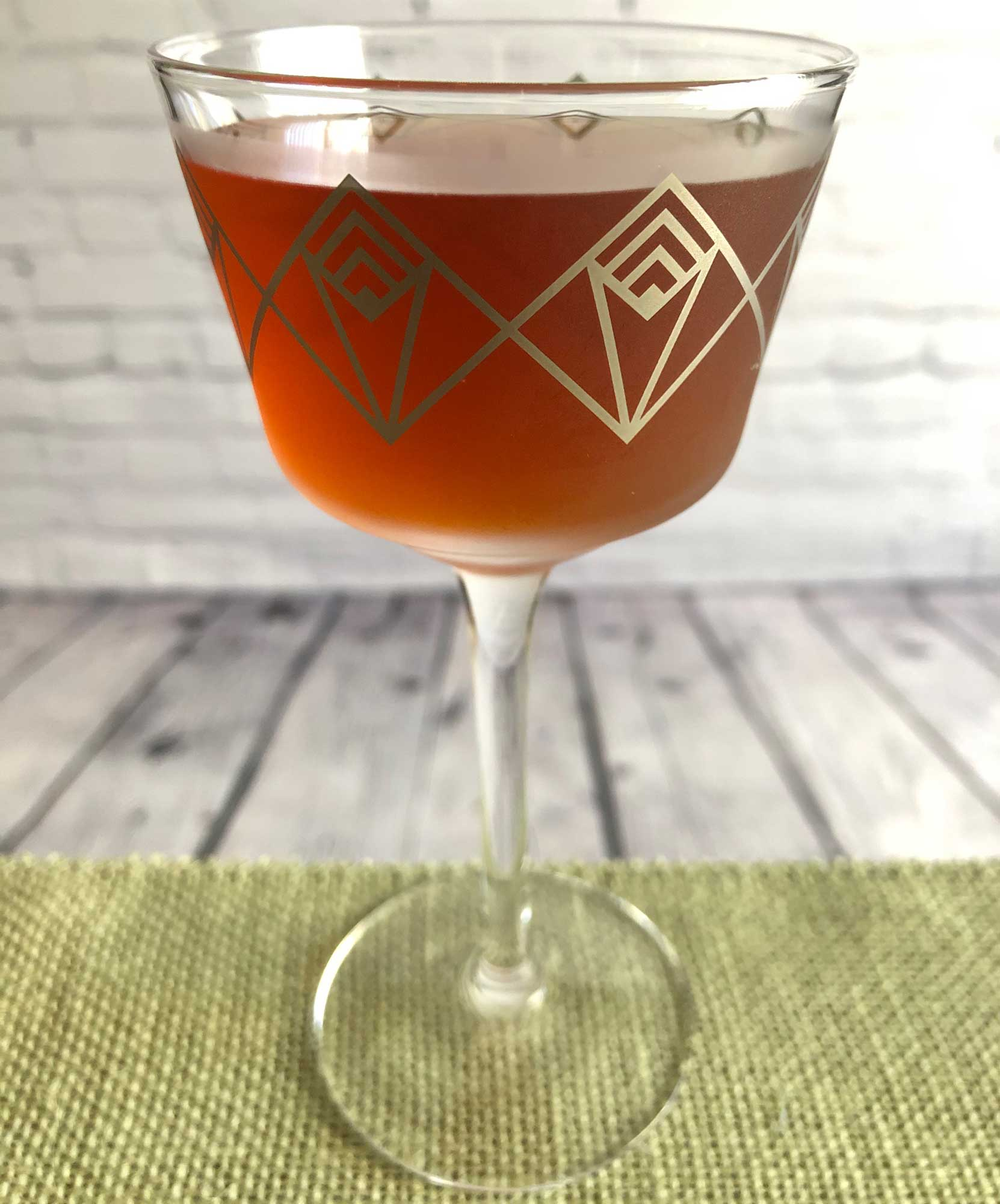 An example of the Careless Whisper, the mixed drink (cocktail), variation from the Whisper, Savoy Cocktail Book, featuring Smith & Cross Traditional Jamaica Rum, Cocchi Vermouth di Torino, Dolin Dry Vermouth de Chambéry, orange bitters, and Angostura bitters; photo by Lee Edwards