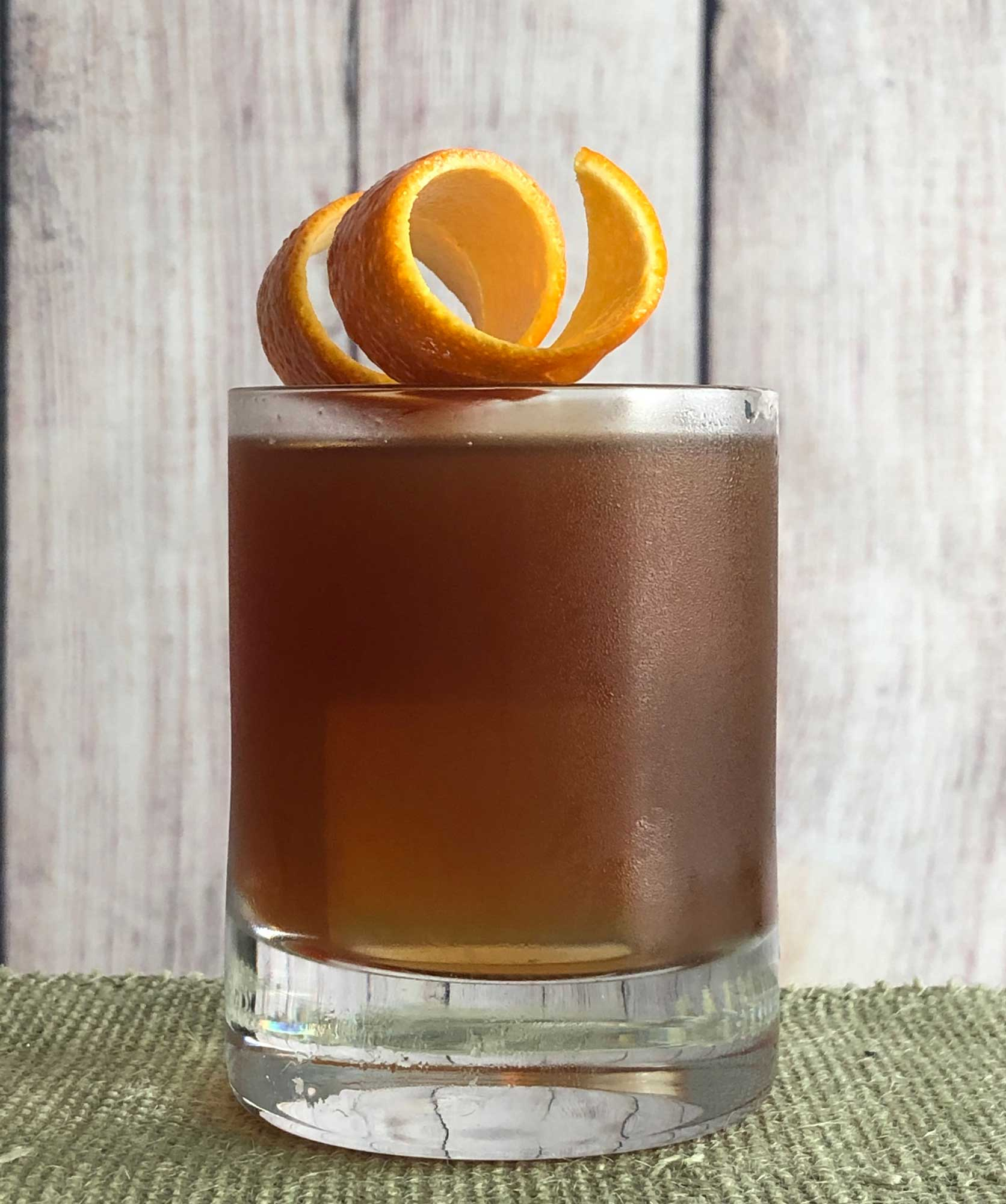 An example of the Sinnerman, the mixed drink (cocktail), variation of a drink by Mike Fleming, Westbridge, Cambridge, MA, featuring Cocchi Vermouth di Torino, Salers Gentian Apéritif, and St. Elizabeth Allspice Dram; photo by Lee Edwards