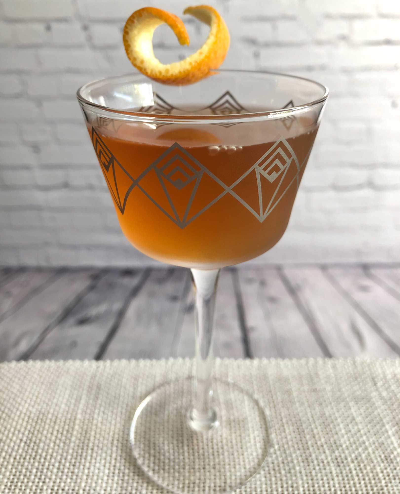 """An example of the Autumn Sunset, the mixed drink (cocktail), by """"Sanctuaria: The Dive Bar of Cocktail Bars"""", featuring bourbon whiskey, Cocchi Vermouth di Torino, Dolin Dry Vermouth de Chambéry, St. Elizabeth Allspice Dram, and Bénédictine; photo by Lee Edwards"""