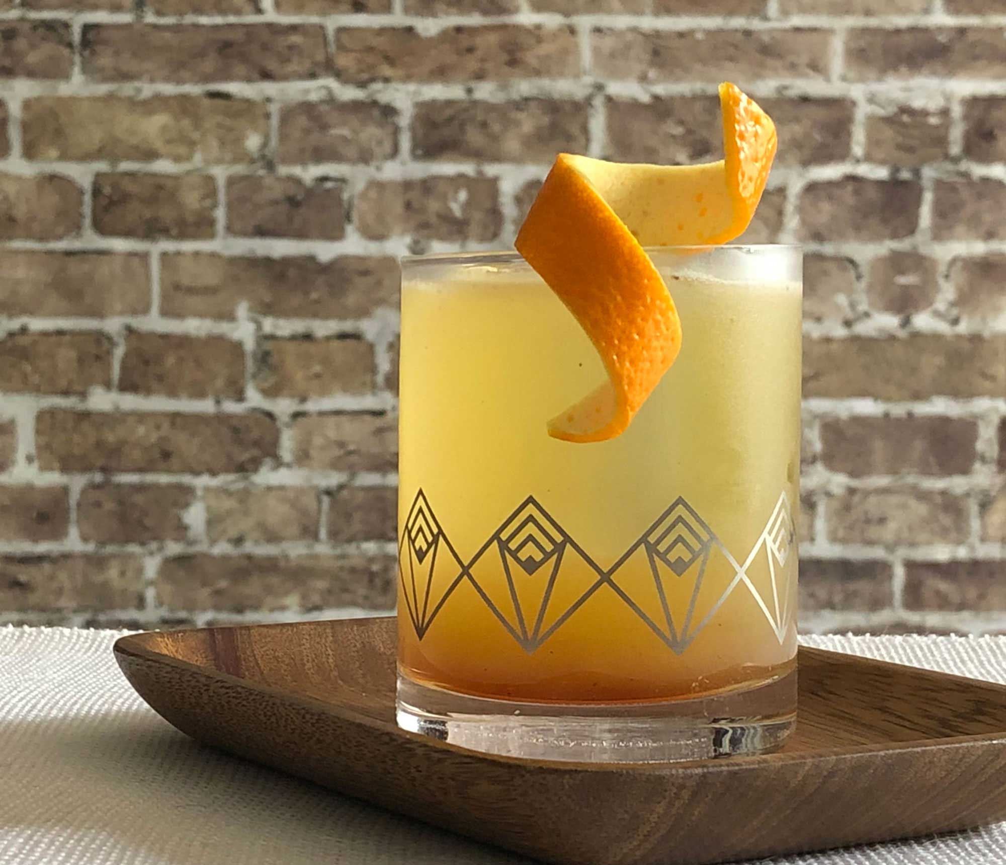 An example of the Prado 86, the mixed drink (cocktail), by Adam Hodak, Green Russell, Denver, featuring mezcal, orange-flavored liqueur, pineapple juice, orange juice, simple syrup, and St. Elizabeth Allspice Dram; photo by Lee Edwards