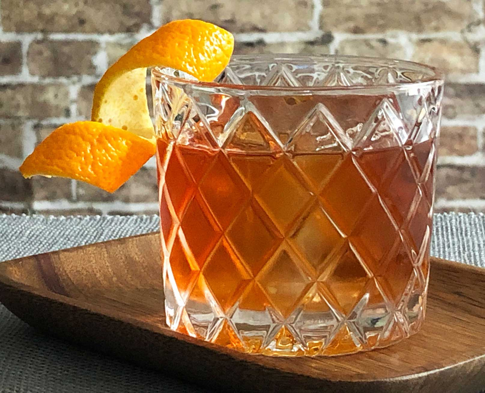 An example of the Rum Old Fashioned, the mixed drink (cocktail) featuring The Scarlet Ibis Trinidad Rum, Smith & Cross Traditional Jamaica Rum, rich demerara syrup, and Angostura bitters; photo by Lee Edwards