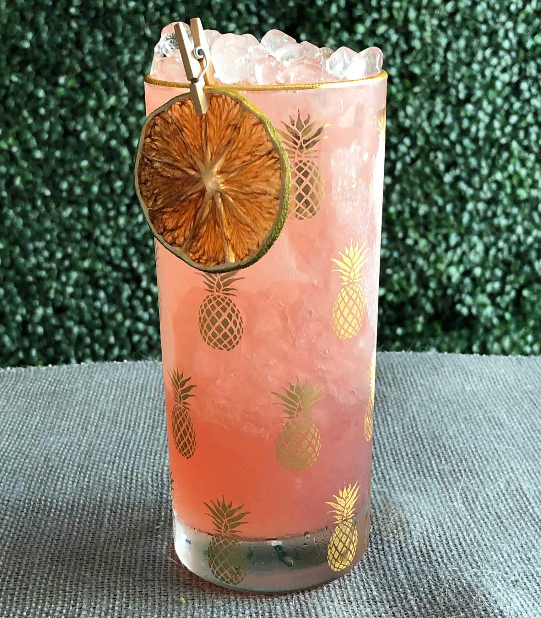 An example of the Zirbenz Swizzle, the mixed drink (frappe), by based on a drink by Jamie Boudreau, Canon, Seattle, Washington, featuring Hayman's Old Tom Gin, Zirbenz Stone Pine Liqueur of the Alps, Dolin Génépy le Chamois Liqueur, lime juice, and simple syrup; photo by Lee Edwards