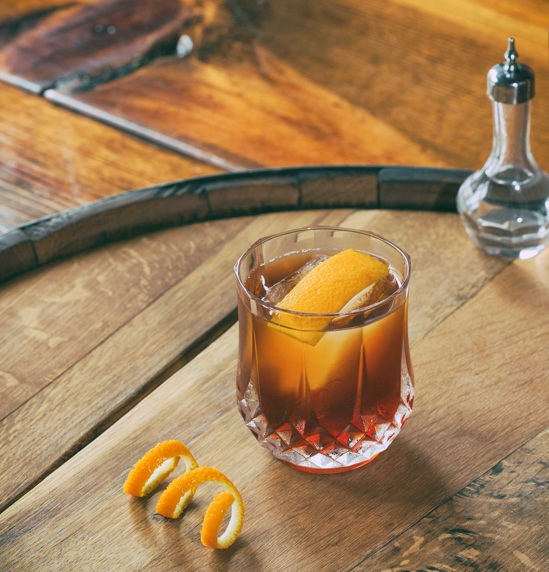 An example of the The Niall, the mixed drink (cocktail), by Ryan Maybee, Manifesto and The Rieger, Kansas City, featuring J. Rieger & Co. Kansas City Whiskey, Cocchi Vermouth di Torino, Aperitivo Cappelletti, Regans' No. 6 Orange Bitters, and Kubler Absinthe Supérieure; photo by Brandon Cummins
