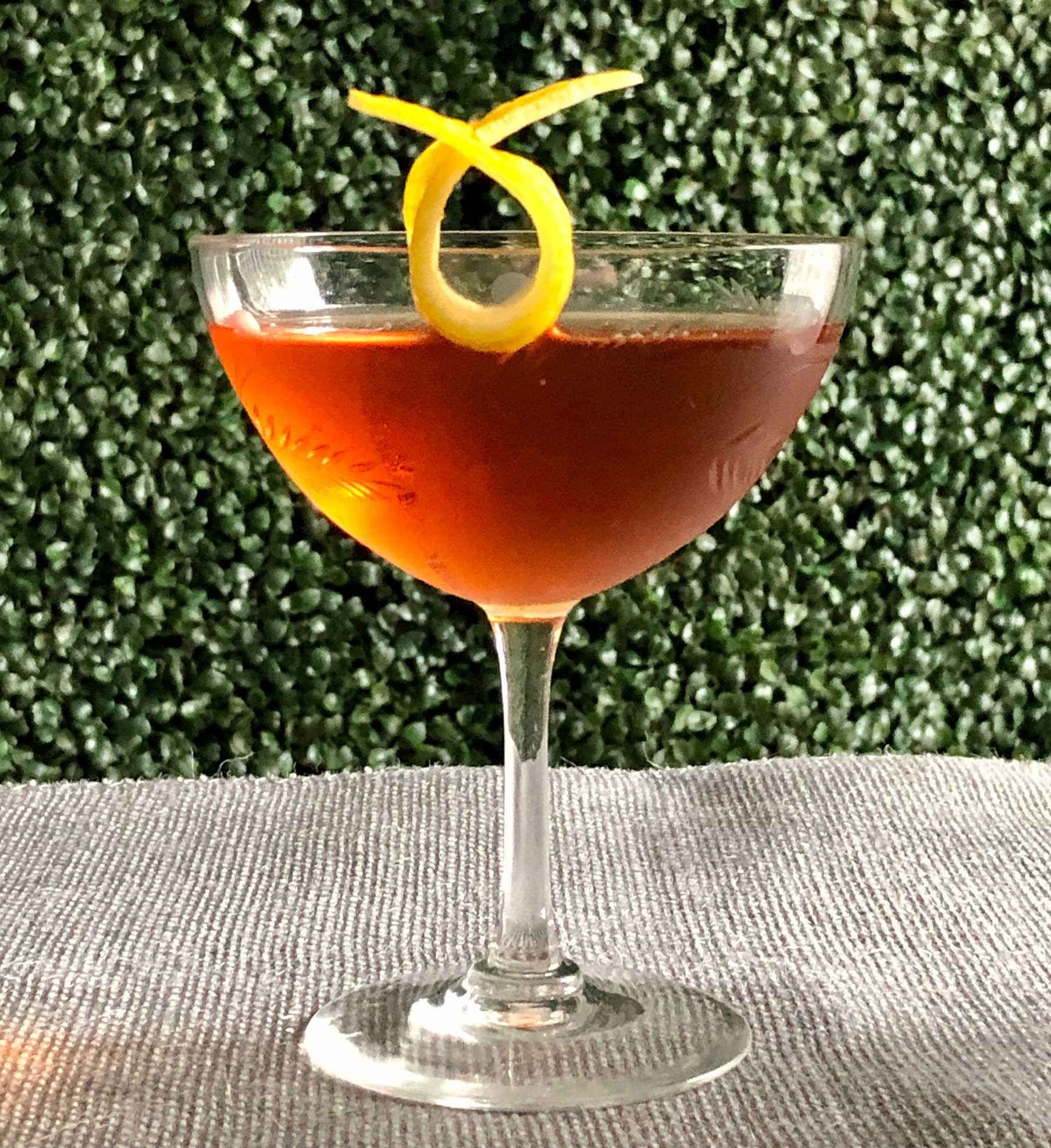 An example of the Mr. Burns, the mixed drink (cocktail), by Jon DeRosa, Oldfields Liquor Room, Los Angeles, featuring Dewar's White Label, Cocchi Vermouth di Torino, and Zirbenz Stone Pine Liqueur of the Alps; photo by Lee Edwards