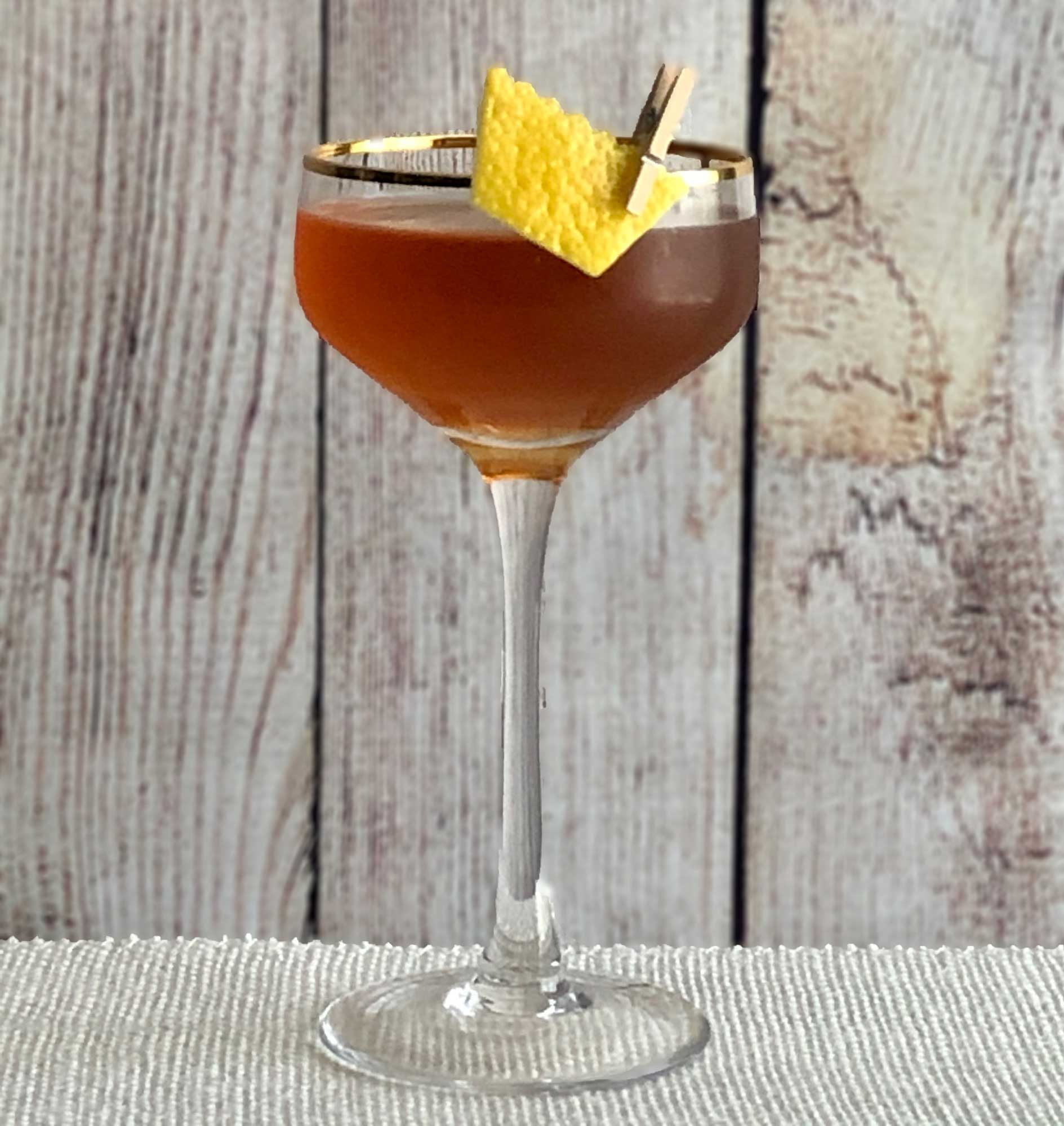 An example of the Return of the King, the mixed drink (cocktail), by John Filby, Augustine, NYC, featuring blended grain scotch or bourbon whiskey, Pasubio Vino Amaro, and Carpano Punt e Mes; photo by Lee Edwards