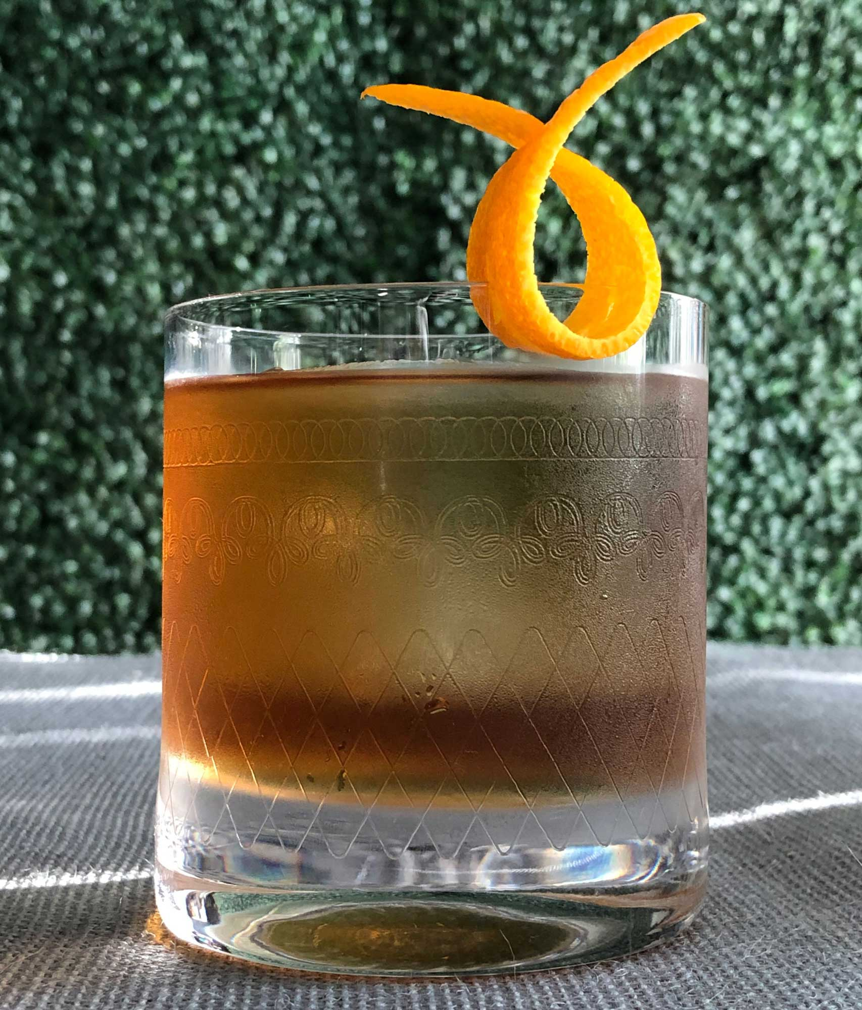 An example of the Piston Honda, the mixed drink (cocktail), by Brandon Wise, Sage Restaurant Group, featuring japanese whisky, Bonal Gentiane-Quina, maraschino liqueur, and orange bitters; photo by Lee Edwards