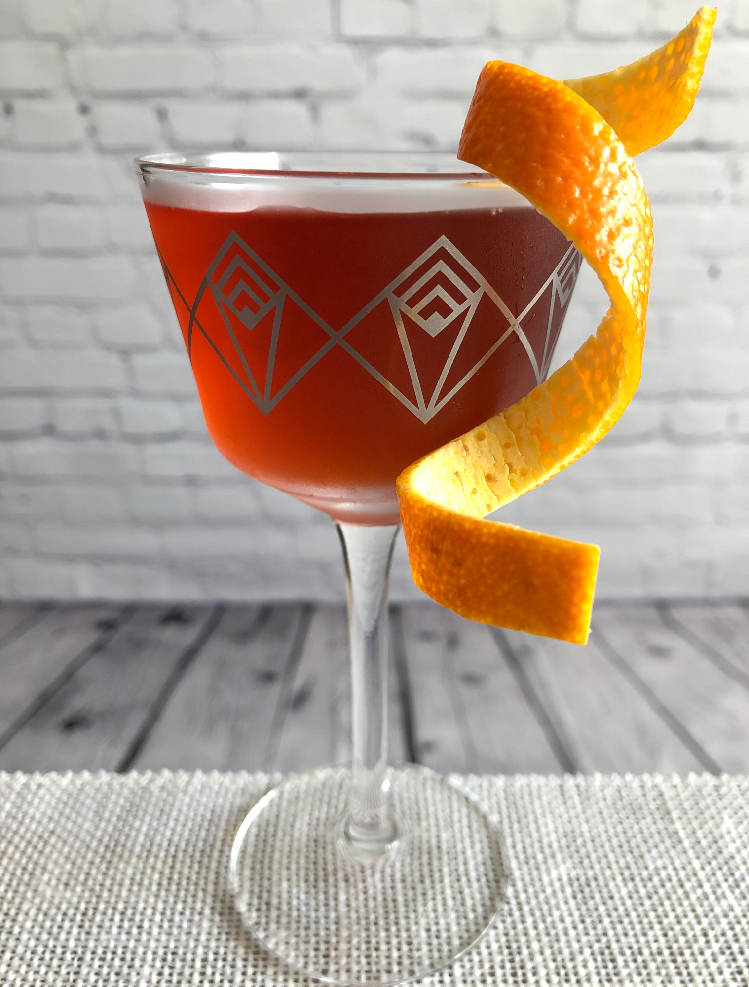 An example of the The Italian Job, the mixed drink (cocktail), by Joseph Akhavan, Mabel, Paris, featuring Smith & Cross Traditional Jamaica Rum, Cocchi Americano Bianco, Aperitivo Cappelletti, Byrrh Grand Quinquina, and orange bitters; photo by Lee Edwards