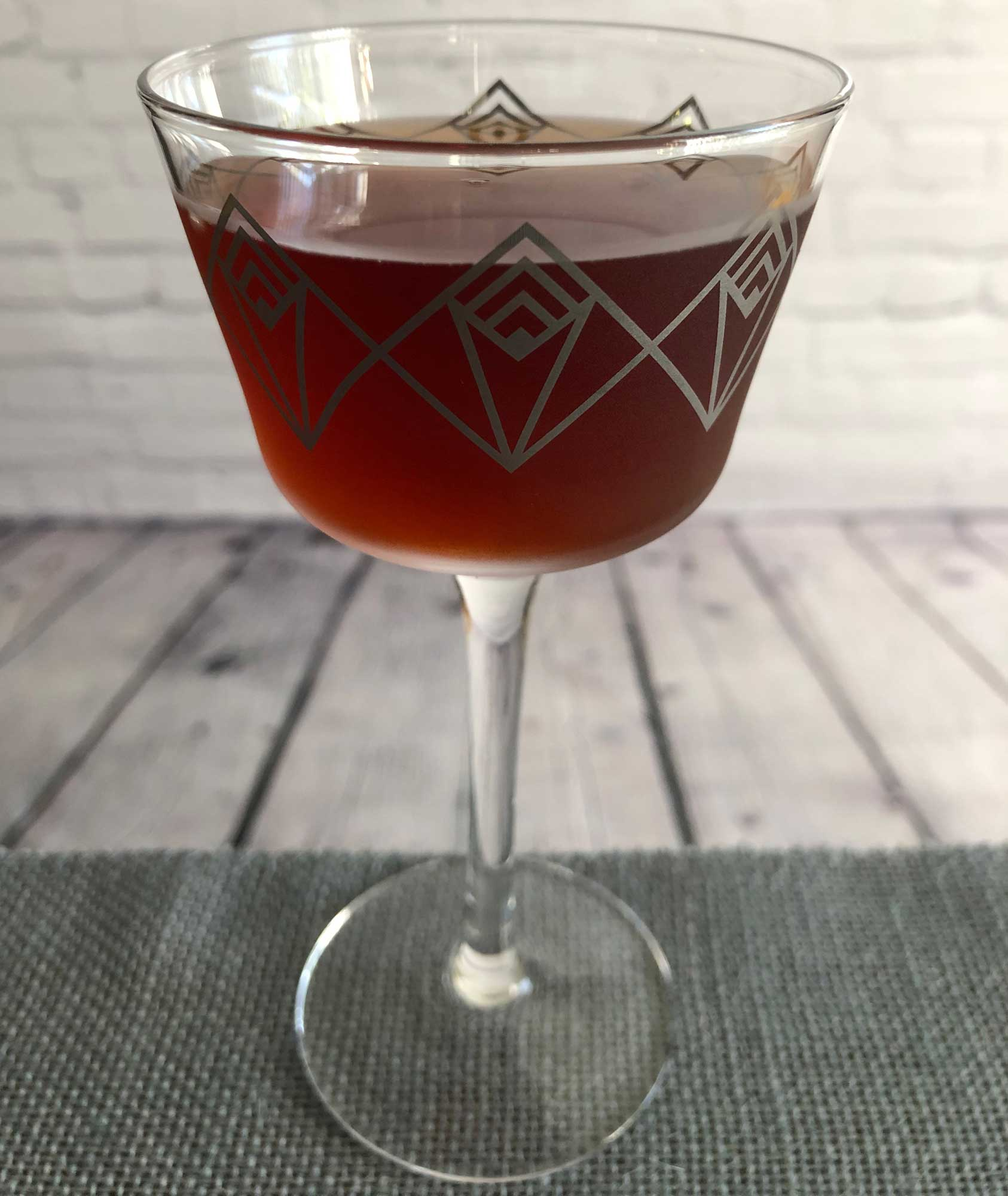 An example of the Navy Cut Shim, the mixed drink (cocktail), by Bob Herczeg, Sur-Lie, Maine, featuring rancio, Cocchi Dopo Teatro Vermouth Amaro, Aperitivo Cappelletti, Smith & Cross Traditional Jamaica Rum, orange bitters, and Laphroaig 10 Year Single Malt Scotch; photo by Lee Edwards