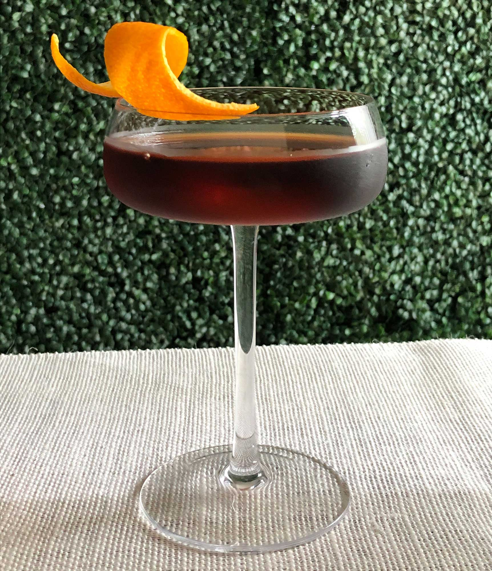 An example of the In Vida Veritas, the mixed drink (cocktail), by Misty Kalkofen, Boston, MA, featuring Del Maguey Mezcal Vida, Zirbenz Stone Pine Liqueur of the Alps, Nux Alpina Walnut Liqueur, Bénédictine, and chocolate bitters; photo by Lee Edwards