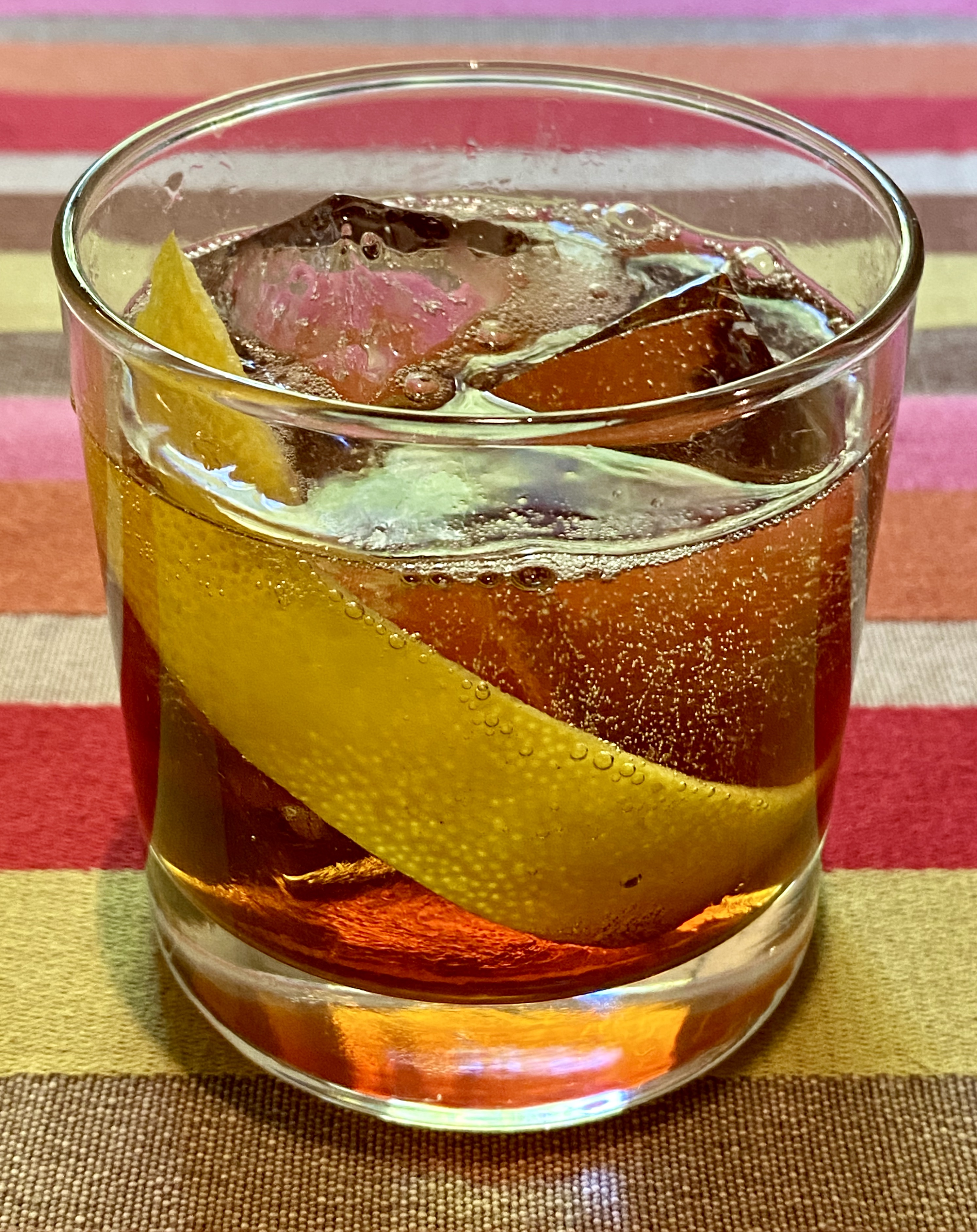 An example of the Mattei Rouge Spritz, the mixed drink (cocktail) featuring Mattei Cap Corse Rouge Quinquina, and soda water or tonic water; photo by Martin Doudoroff