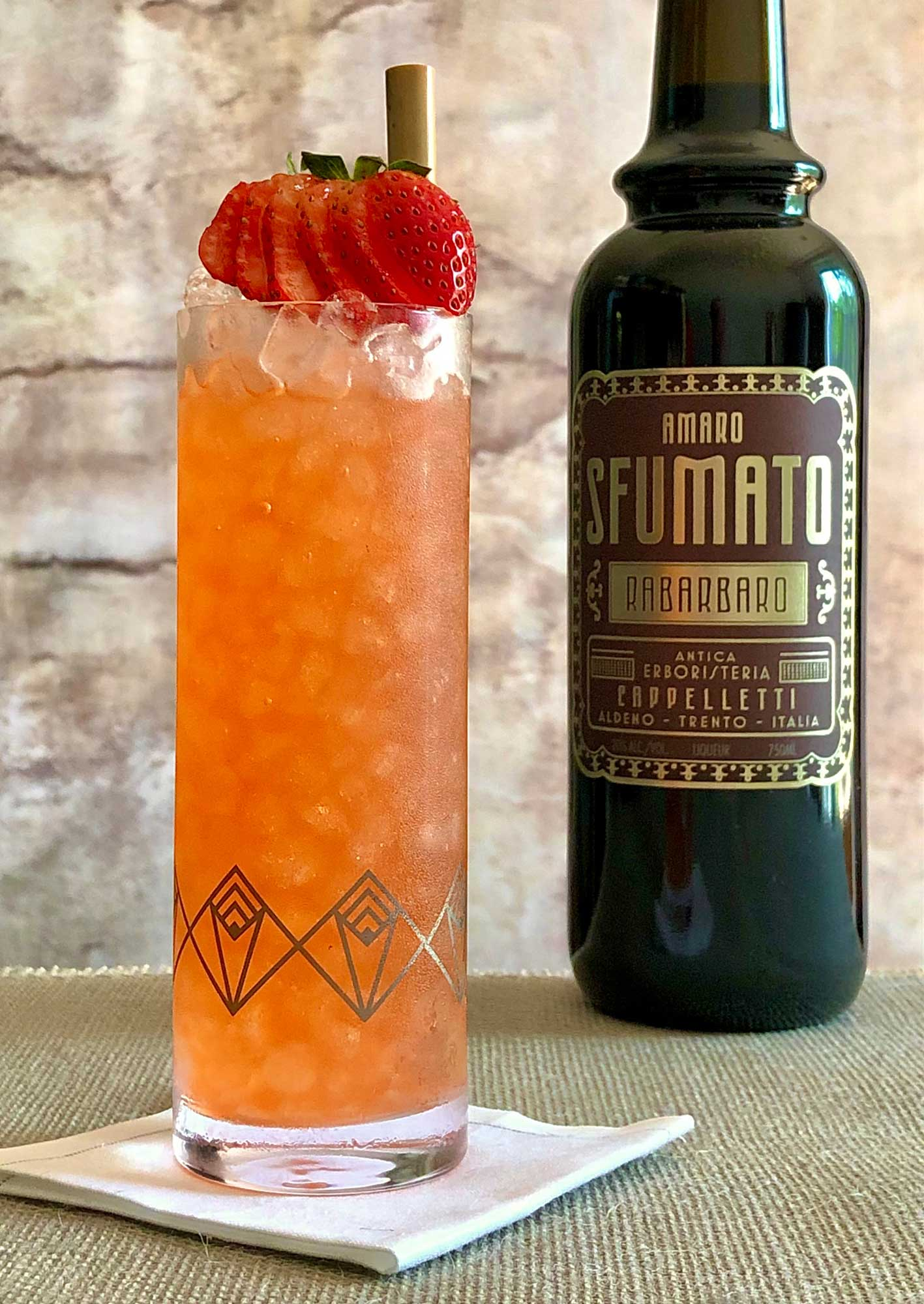 An example of the Lucky Duck Collins, the mixed drink (collins), by Kevin Bradel, Raines Law Room, NYC, featuring Plymouth Gin, seltzer, lemon juice, simple syrup, and Amaro Sfumato Rabarbaro; photo by Lee Edwards