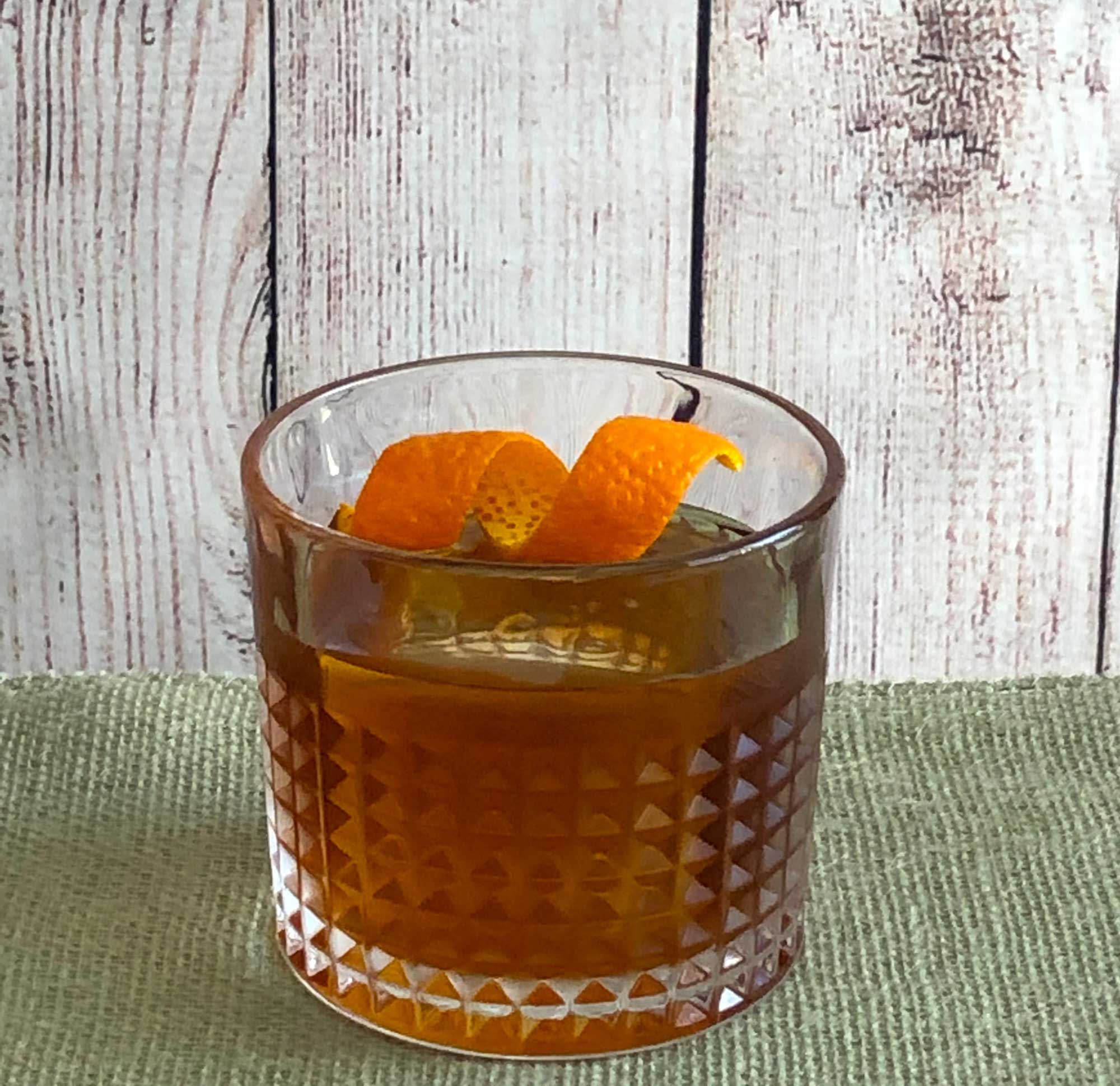 An example of the Negroni con Fumo, the mixed drink (cocktail) featuring Amaro Sfumato Rabarbaro, Hayman's Royal Dock Navy Strength Gin, and red vermouth; photo by Lee Edwards