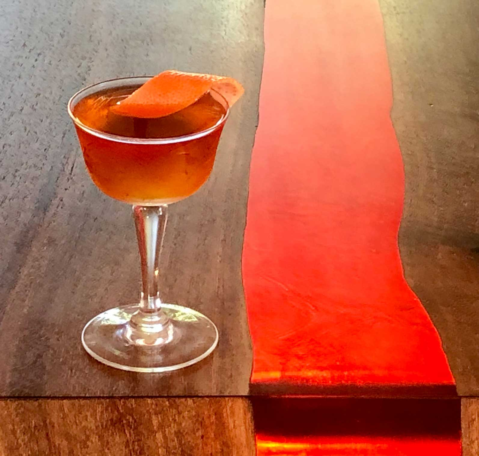 An example of the Rum al Pastor, the mixed drink (cocktail) featuring Plantation Pineapple Original Dark Rum, Amaro Sfumato Rabarbaro, and orange bitters; photo by Lee Edwards