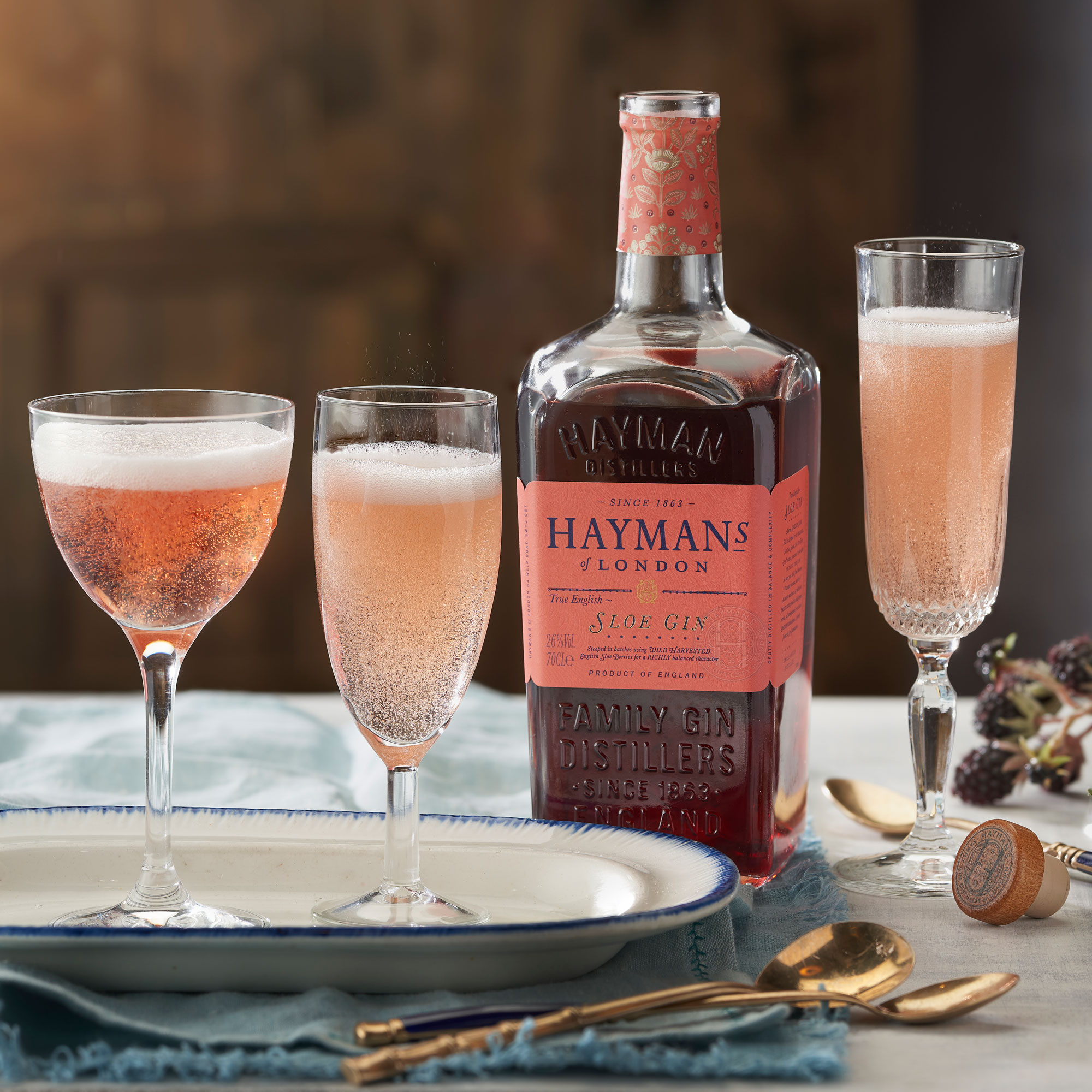 An example of the Sloe Royale, the mixed drink (cocktail) featuring sparkling wine, and Hayman's Sloe Gin; photo by Hayman Distillers