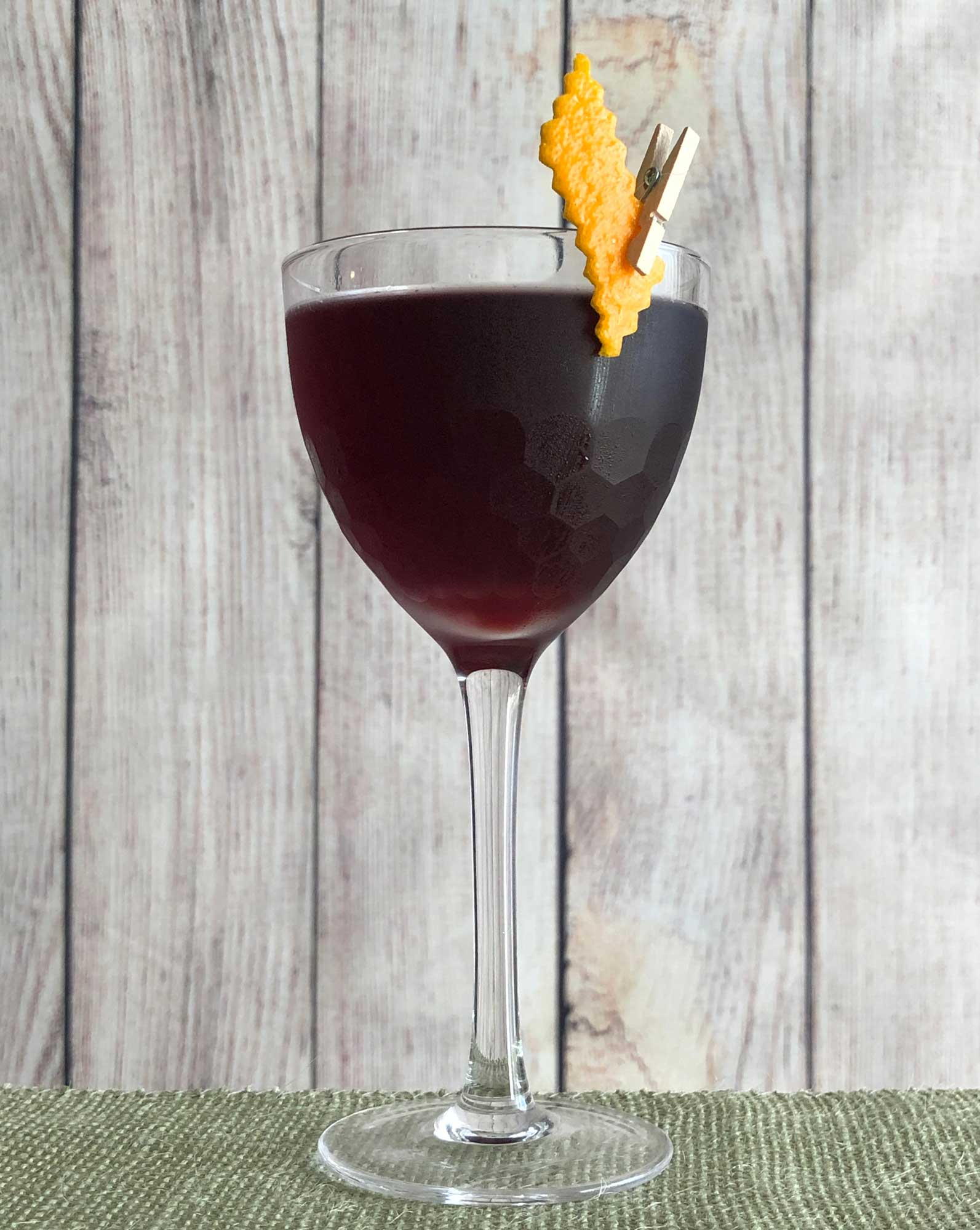 An example of the Aunt Cathy's Old Time Potion, the mixed drink (cocktail) featuring dry red wine, Averell Damson Plum Gin Liqueur, Campari, orange bitters, and Fee Brothers Black Walnut Bitters; photo by Lee Edwards