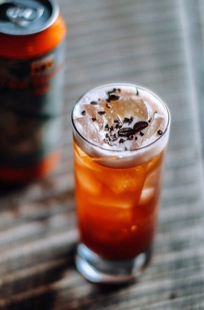 An example of the Beermüth, the mixed drink (cocktail), by Gavin Pierce, Room 11, Washington D.C., featuring Byrrh Grand Quinquina, india pale ale, coffee syrup, lemon juice, and drinking chocolate