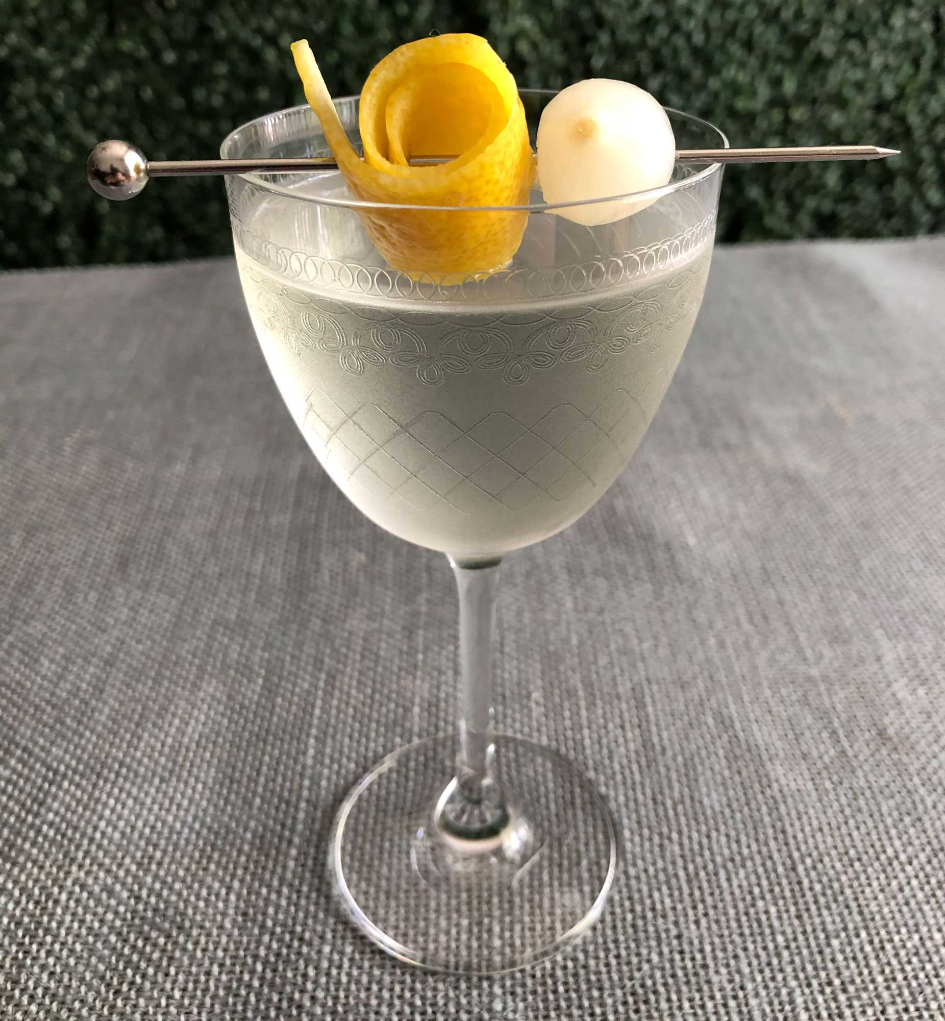 An example of the Roslyn Cocktail, the mixed drink (cocktail) featuring Hayman's London Dry Gin, Comoz Vermouth Blanc, Pernod, and rose water; photo by Lee Edwards