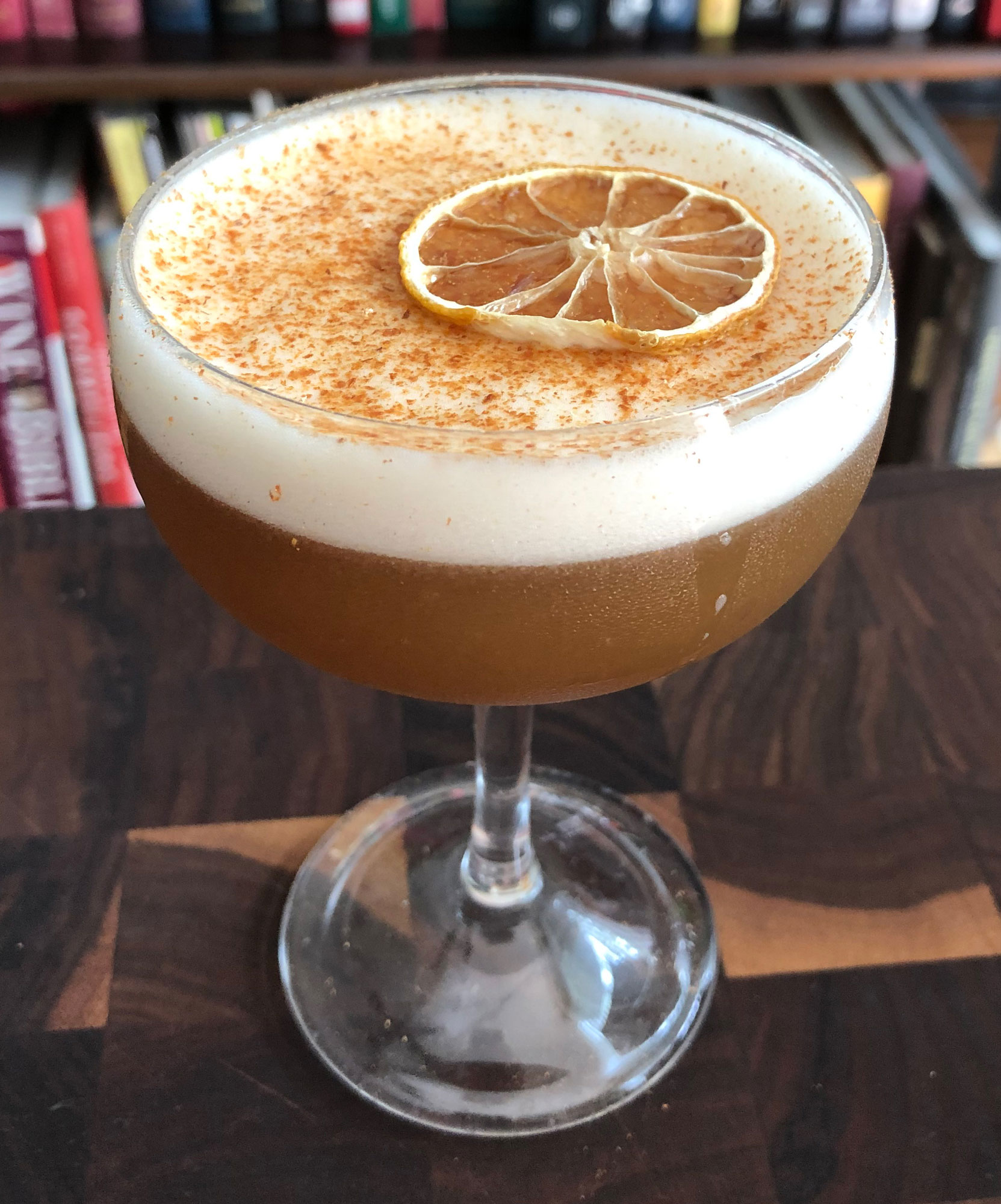 An example of the Golden Brown, the mixed drink (cocktail), by Angelica Tea Room, Buffalo NY, featuring Bonal Gentiane-Quina, rye whiskey, lemon juice, egg white, cinnamon-infused sugar syrup, and Angostura bitters; photo by Lee Edwards