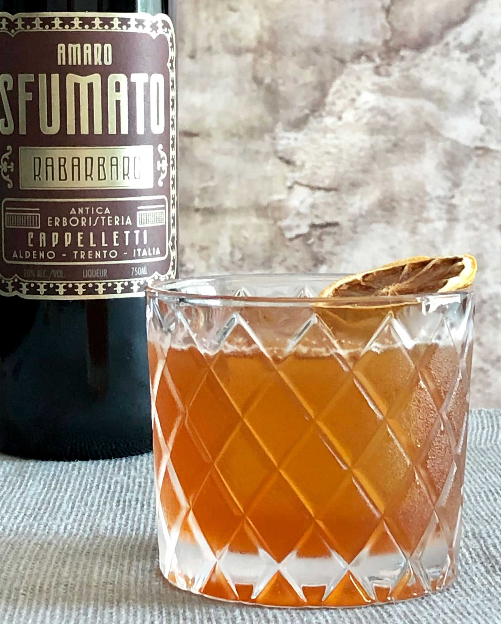 An example of the Welcome, Ghosts, the mixed drink (cocktail), by Nic Christiansen, Louisville, KY, featuring Copper & Kings Immature Brandy, Amaro Sfumato Rabarbaro, lemon juice, honey syrup, Angostura bitters, and chocolate bitters; photo by Lee Edwards