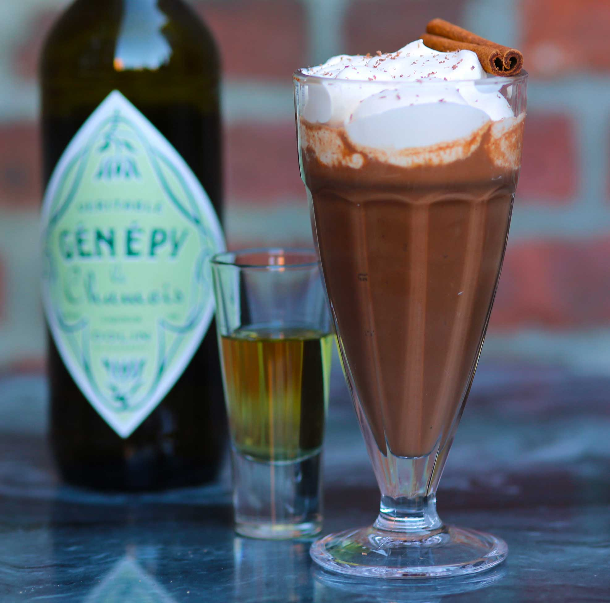 An example of the Verte Chaud No. 2, the mixed drink (cocktail), Adapted from a drink by Jamie Boudreau, Seattle, WA, featuring drinking chocolate, Dolin Génépy le Chamois Liqueur, and Nux Alpina Whipped Cream; photo by Lauren Clark