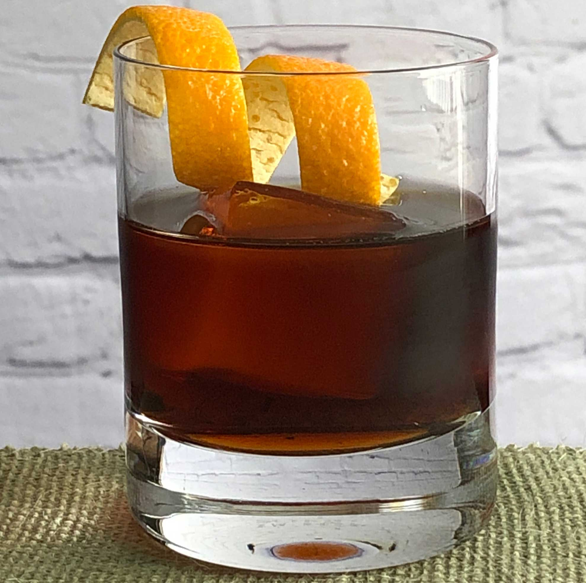 An example of the Amaricanto, the mixed drink (cocktail) featuring Cocchi Vermouth di Torino, Elisir Novasalus, and orange bitters; photo by Lee Edwards
