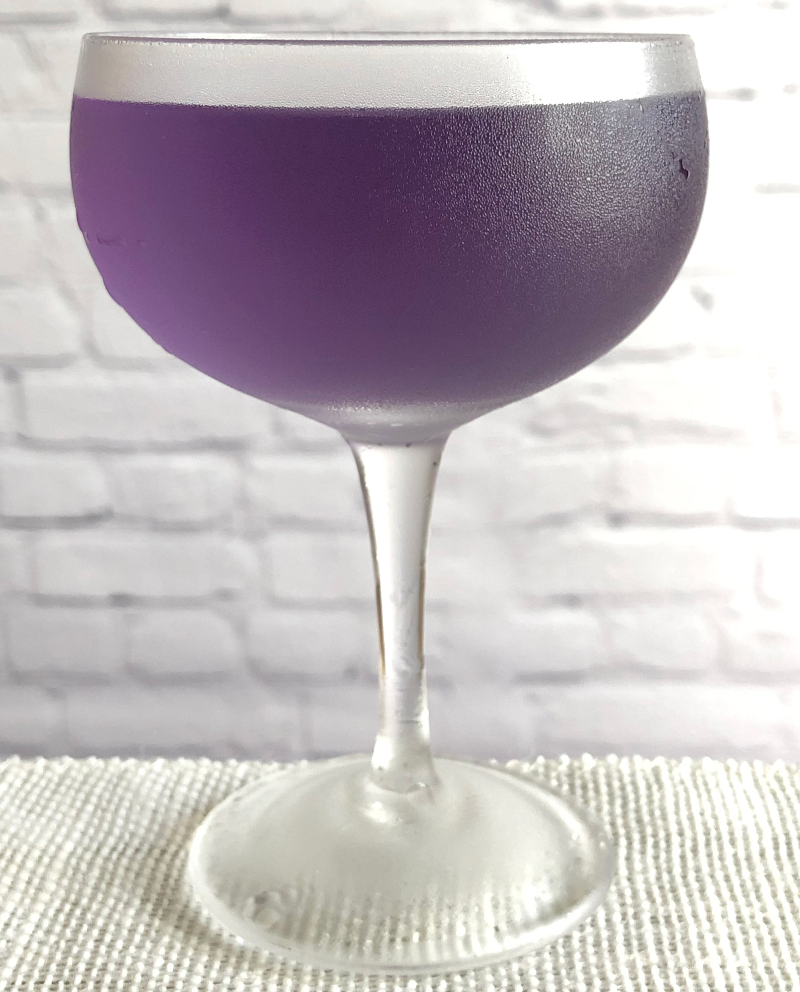 An example of the Yale Cocktail, the mixed drink (cocktail), by Eric Felten, Wall Street Journal, featuring Hayman's London Dry Gin, Rothman & Winter Crème de Violette, Dolin Dry Vermouth de Chambéry, and Angostura bitters; photo by Lee Edwards